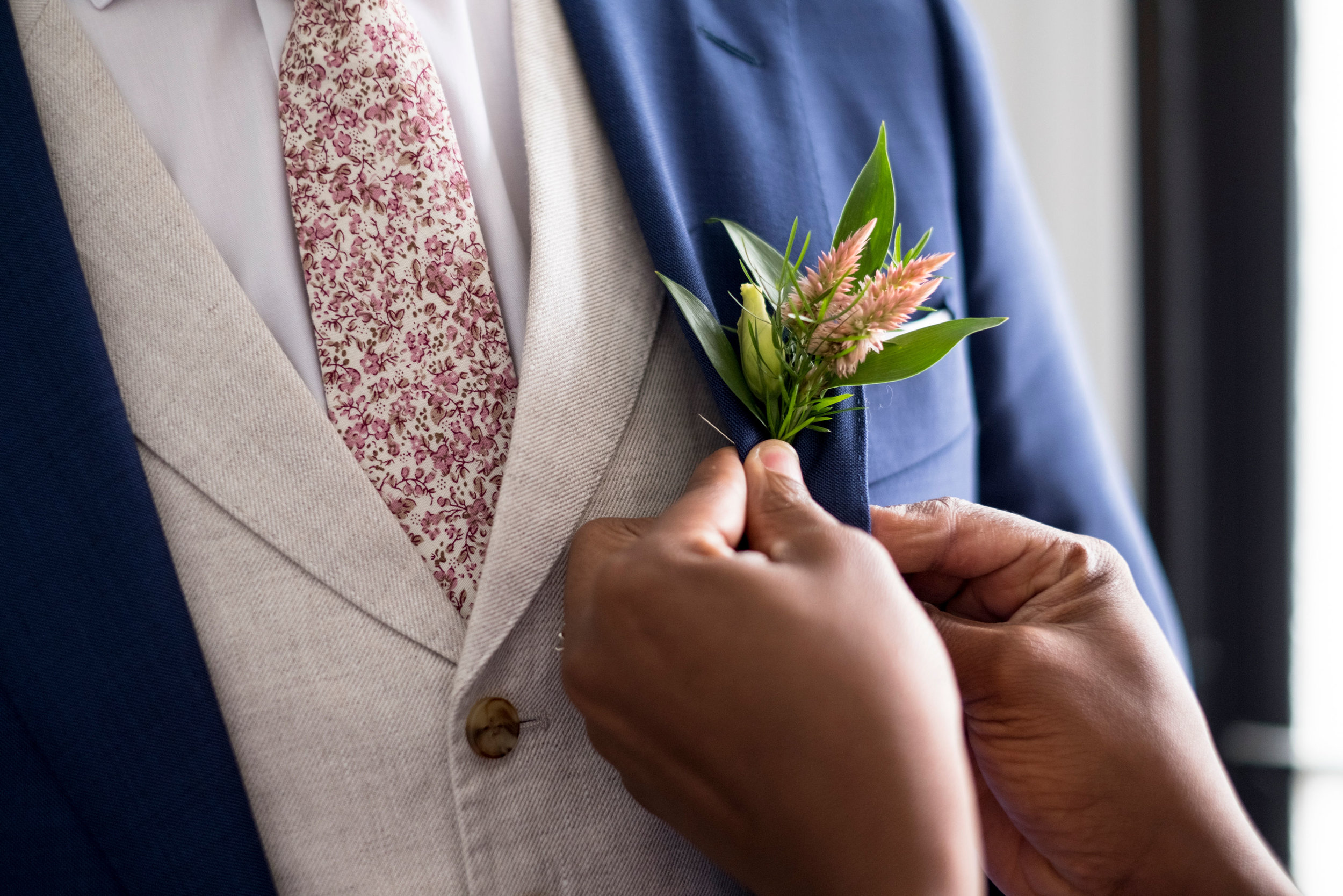 Each pinned boutonniere means the world to Beauty Marked Events!   Photography by Zachary Hartzell Photography, LLC