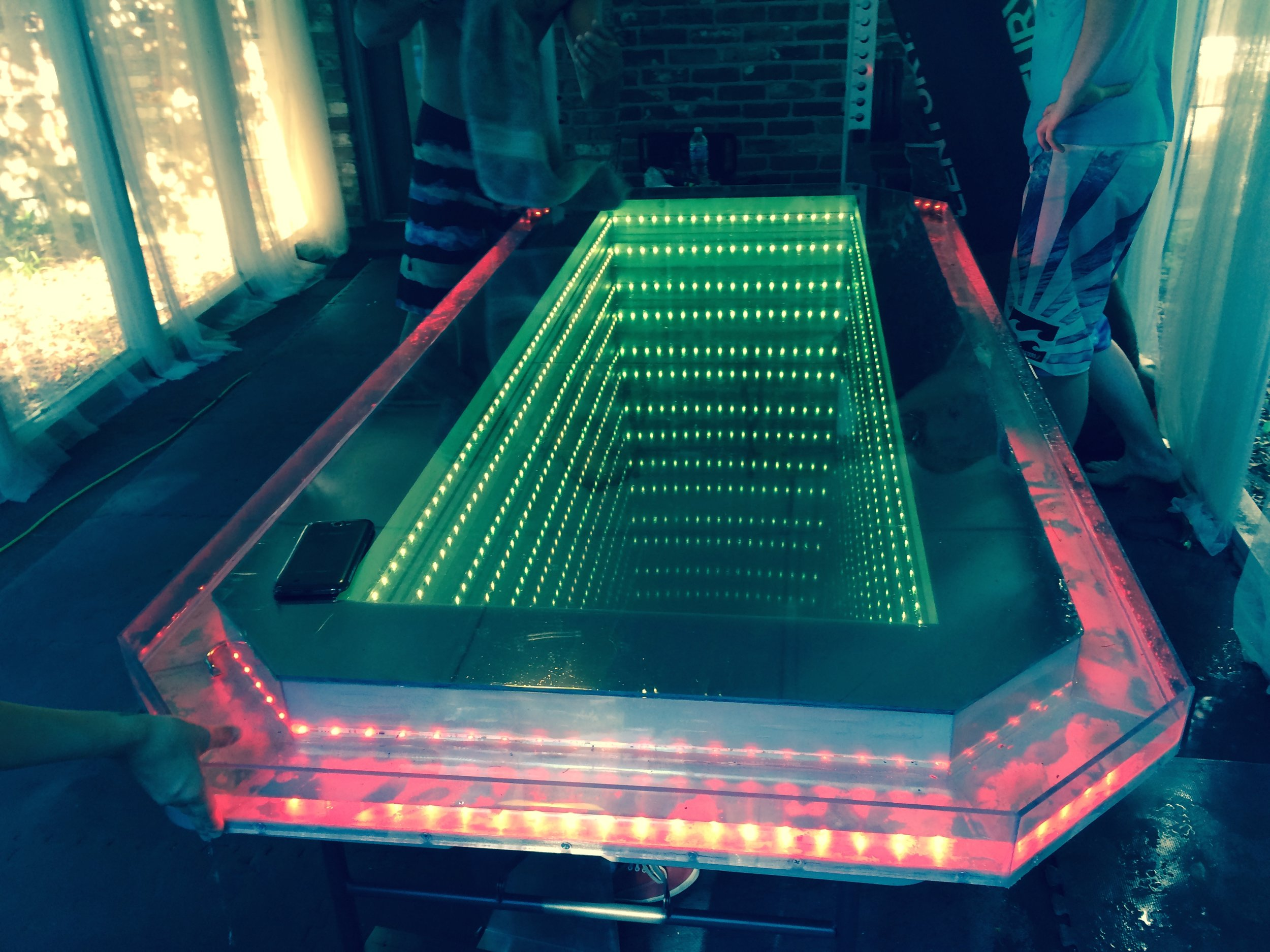 Just for the nerds, our infinity glass beer pong table. Complete with wrap around water moat.