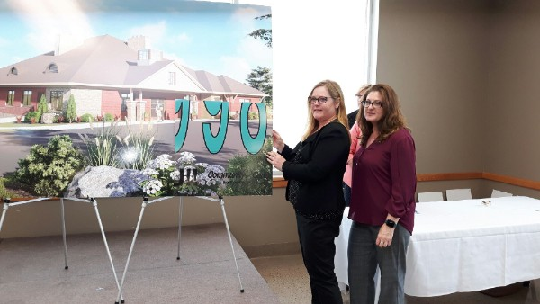 Cathy Foster and Lisa Fowler represented Ganaraska Financial Credit Union - whose employees chose the Ed's House Northumberland Hospice Care Centre to support through their payroll deductions – in helping to unveil the final fundraising campaign total at this week's celebration event.