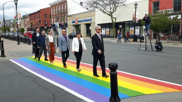 councillors crossing the rainbow Crosswalk - from the front, Mayor John Henderson, Deputy Mayor Suzanne Seguin, and councillors Brian Darling, Nicole Beatty, Aaron Burchat and Adam Bureau