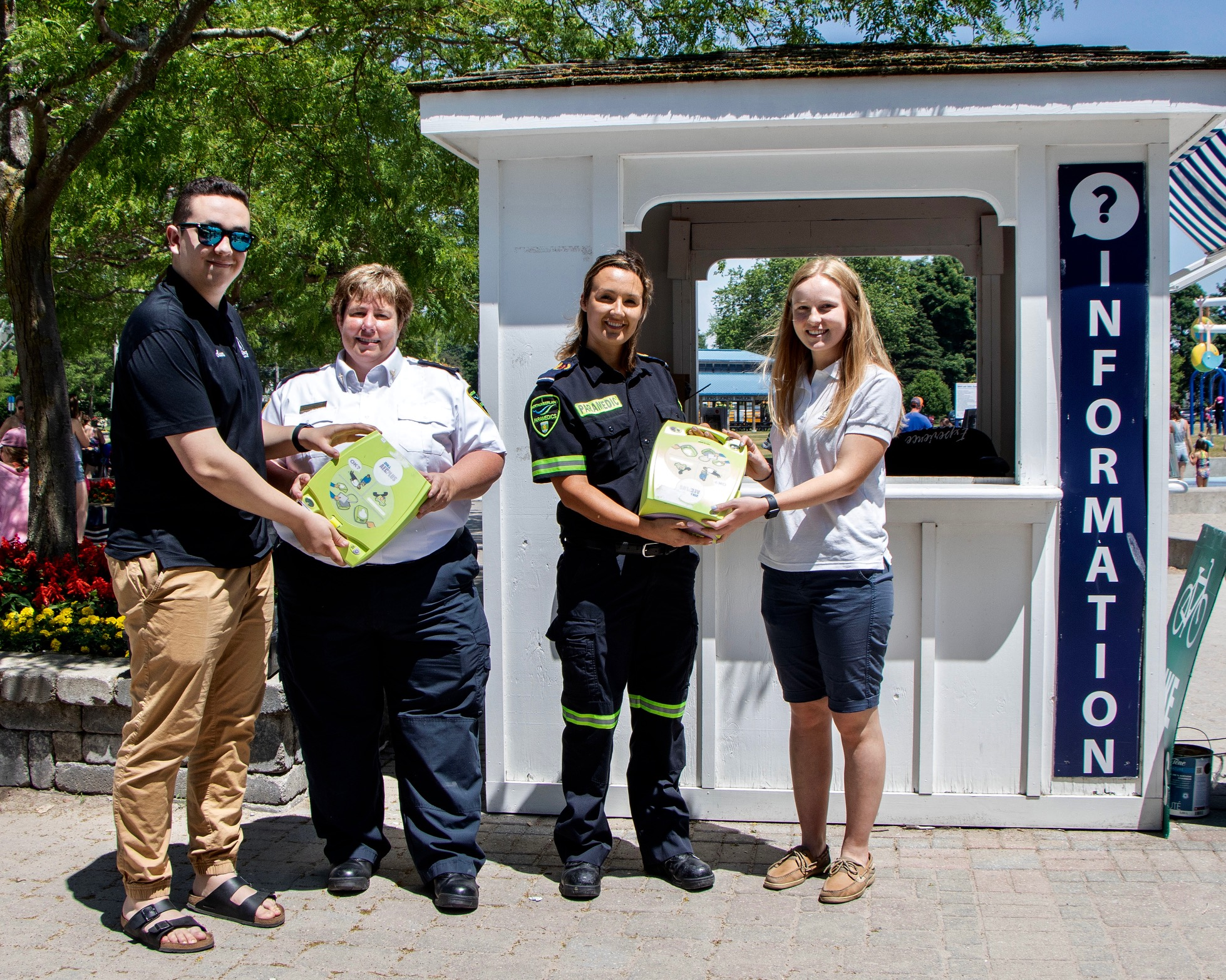 From left, Town of Cobourg Experience Ambassador Sam Brown, Northumberland Paramedics Deputy Chief Susan Brown, paramedic Ersie Cornish and Victoria Park Campground attendant Diana May.