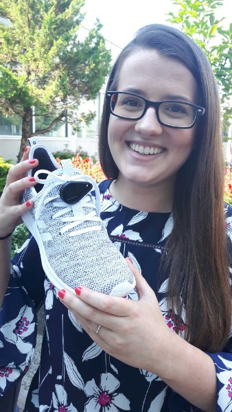 Amy with the device threaded onto a running shoe