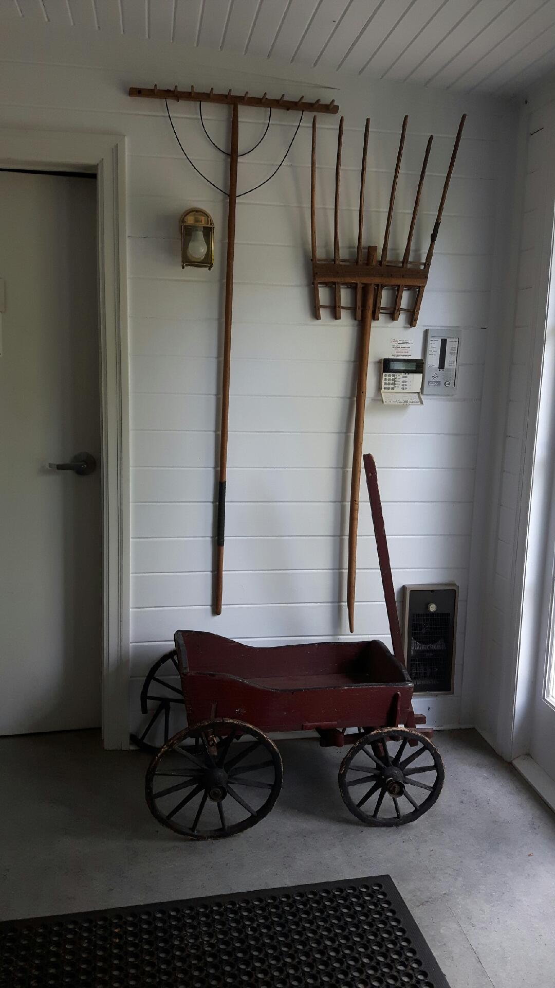 Inside the west entrance is a display of old gardening implements