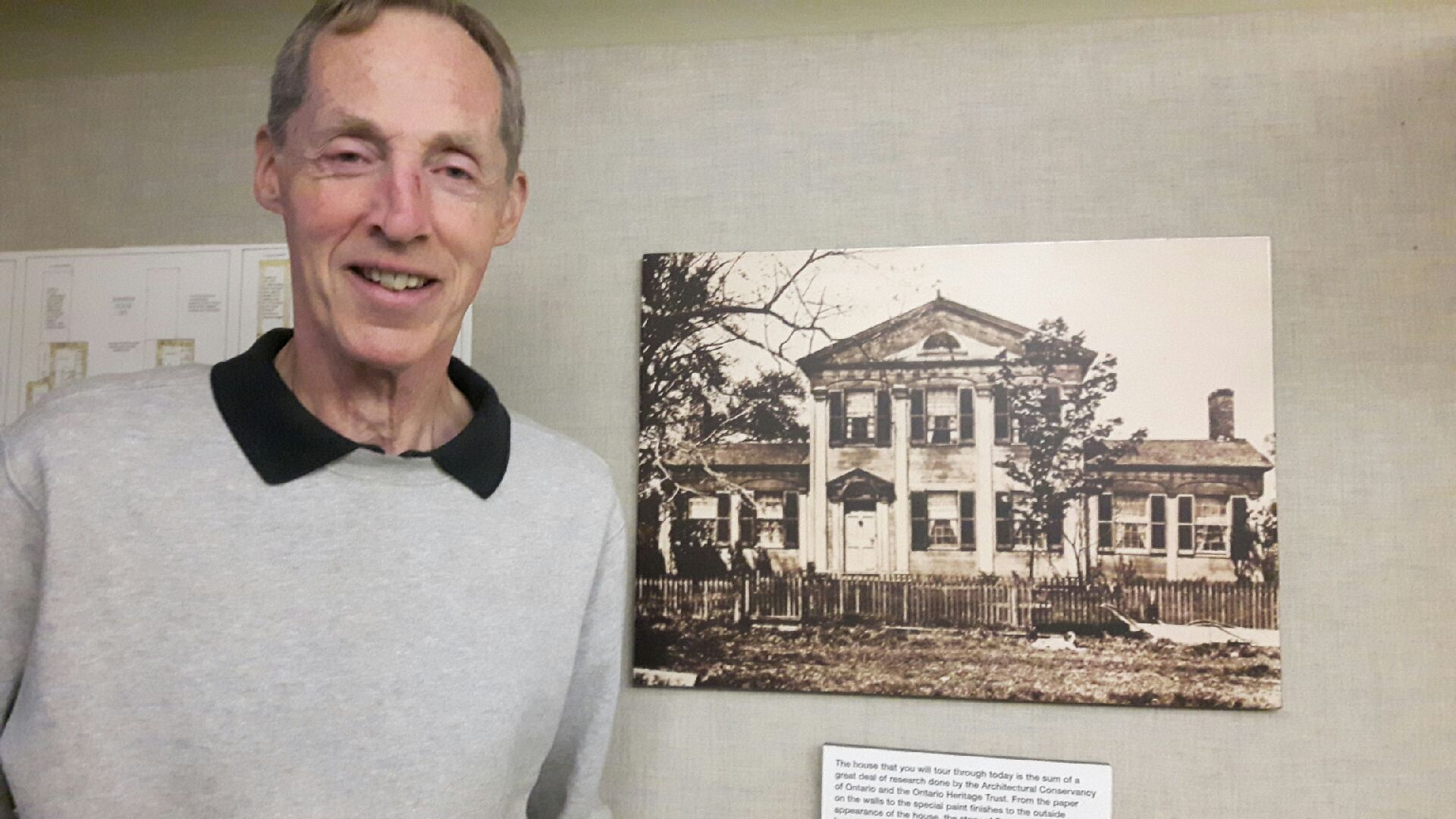 Architectural Conservancy of Ontario East Northumberland branch director Richard Holland is seen with an iconic photo of Barnum House.