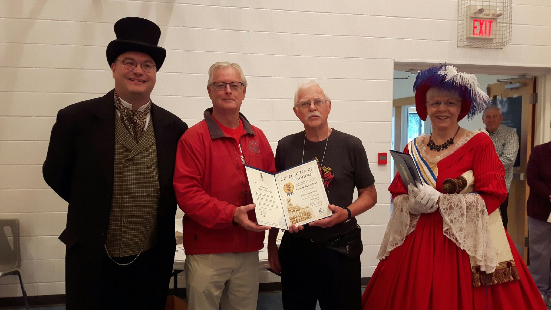 Official town greetings are received - from left, Franklin, Henderson, club president Malcolm Pacey and Robinson. The James Cockburn table is seen with all proclamations and presentations made