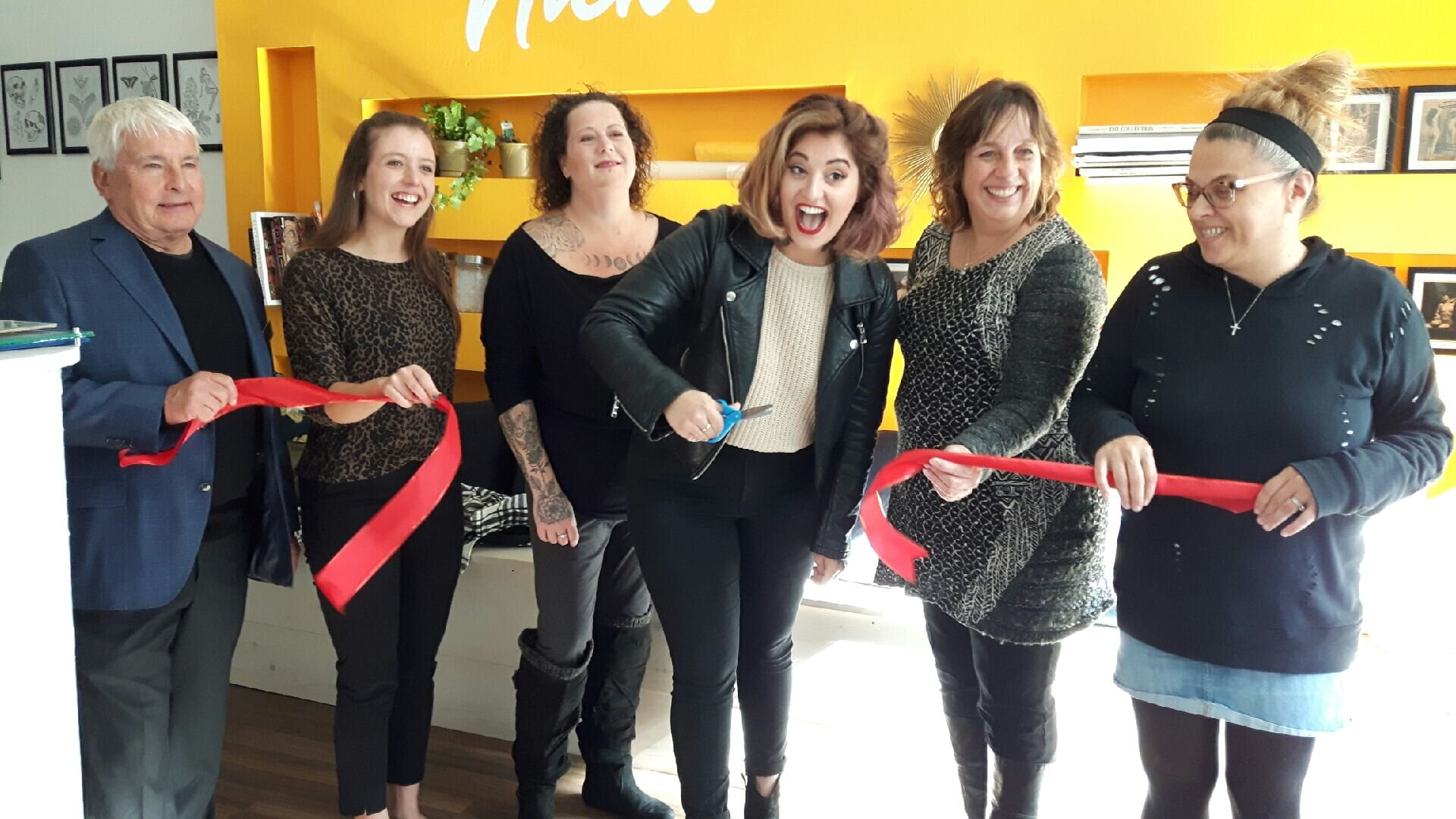 From left, Port Hope Deputy Mayor Les Andrews, MPP representative Paige Wiggins, Nick's staffer Gerry Barnes and owner Nickola Pandelides, HBIA manager Jamie Byers and Port Hope & District Chamber of Commerce representative Maria Papaidannoy-Duk cut the ribbon at Nick's grand opening Friday