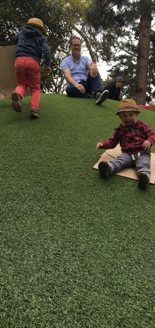 Children Sliding Down a Hill at Santa Barbara Zoo