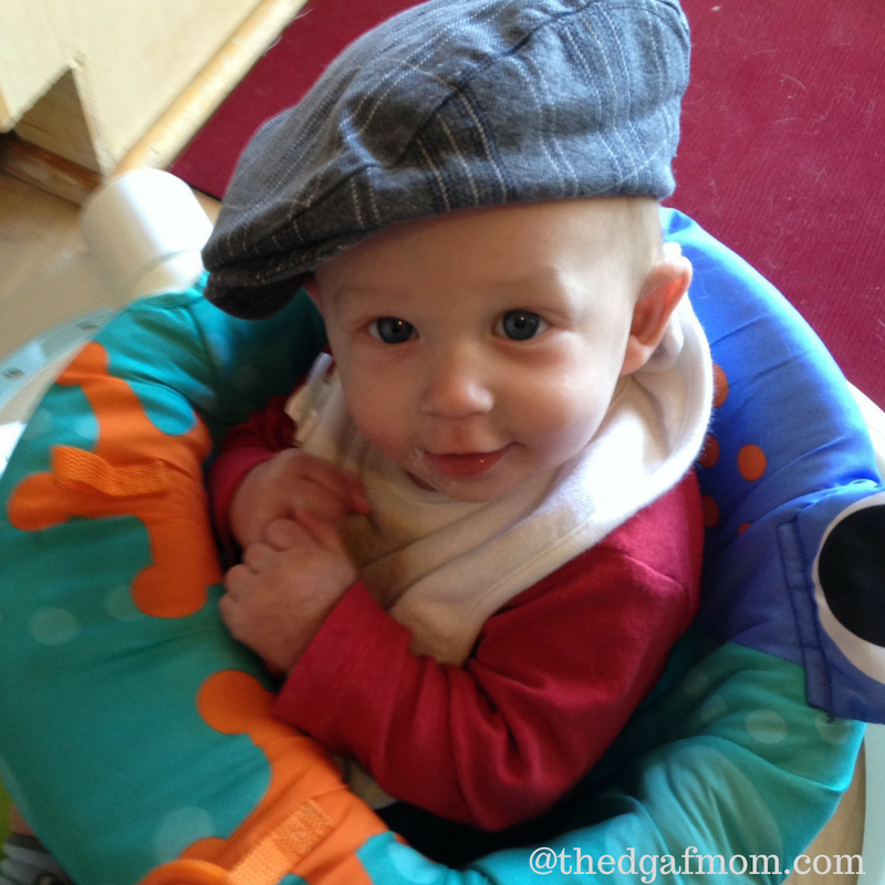 Baby wearing a page boy cap