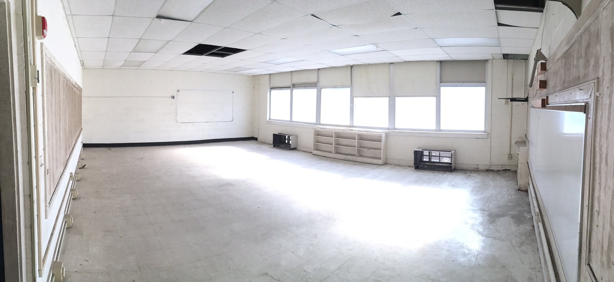 Current condition of Old Chicora classroom. Each classroom will be divided into three to four artist work studios. Natural light and high ceilings allow light to penetrate the space.