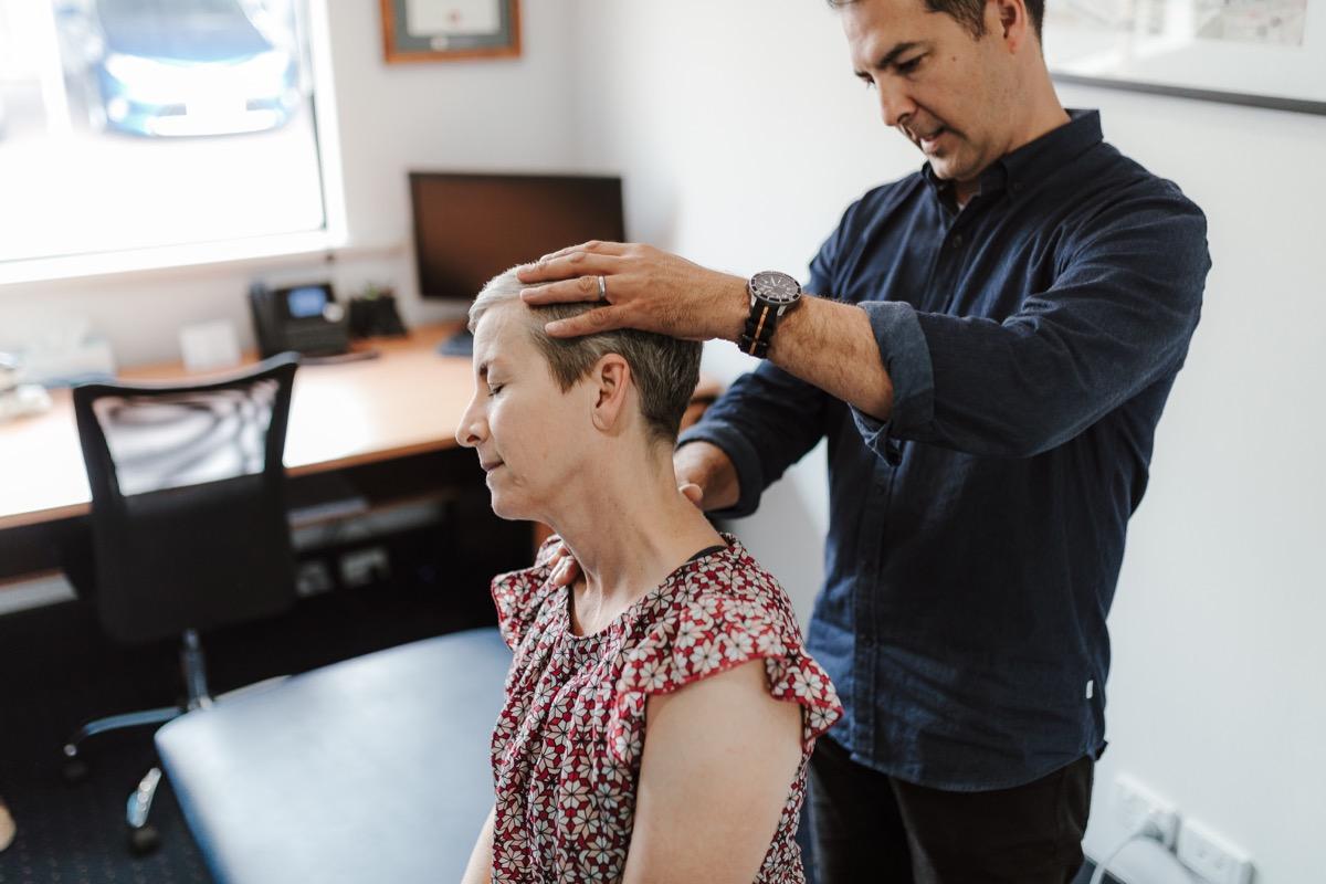 Physiotherapist examining the range of motion of the neck