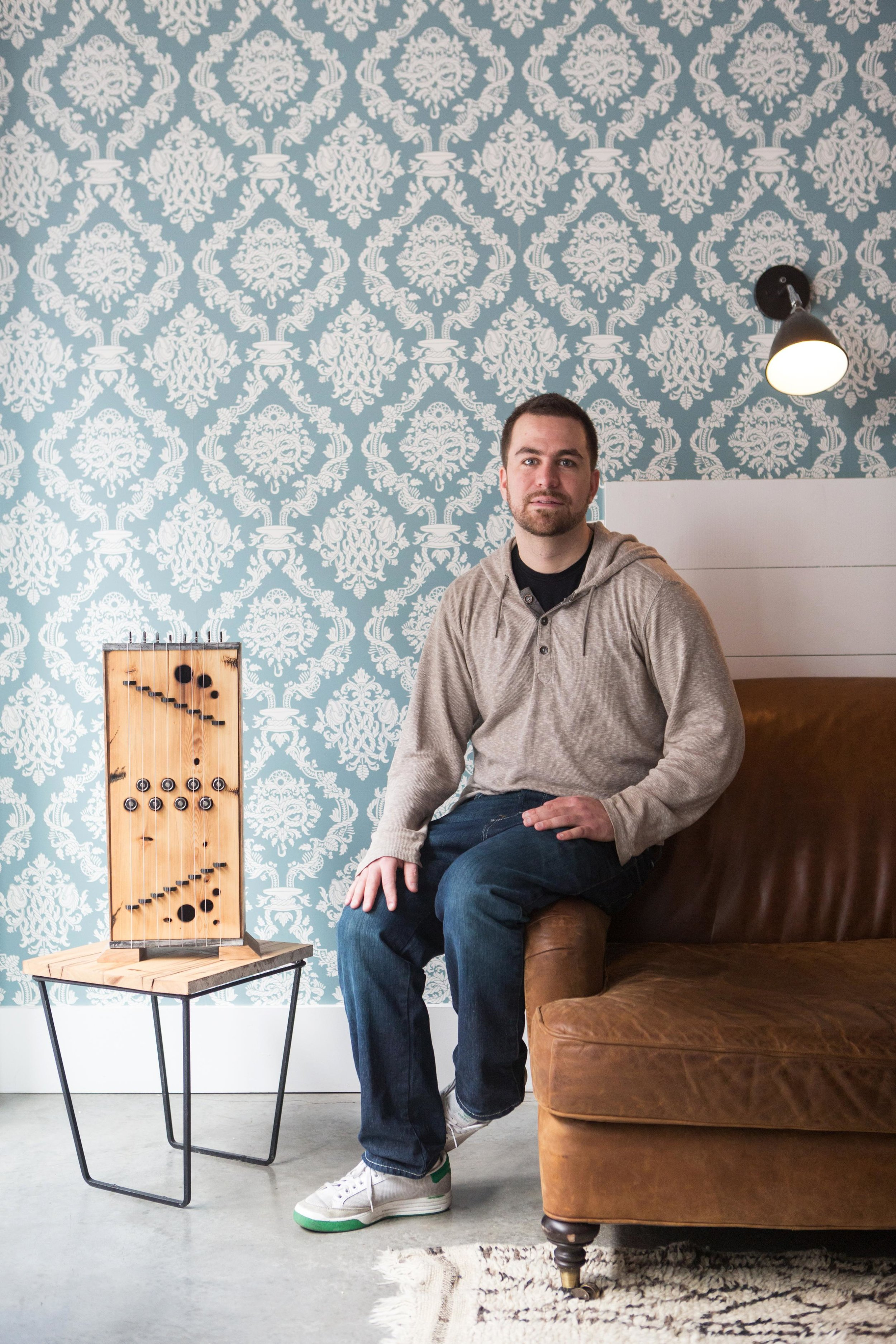 MJ Caselden with one of his sound sculptures in a suite room at the Wythe Hotel in New York City.