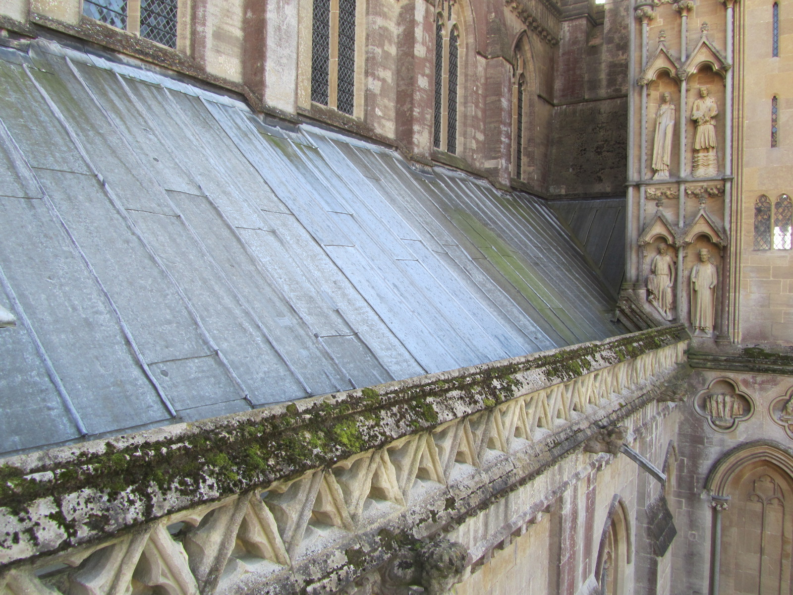 Prior to works: Numerous lead sheets had slipped causing water ingress and decay to the structure below