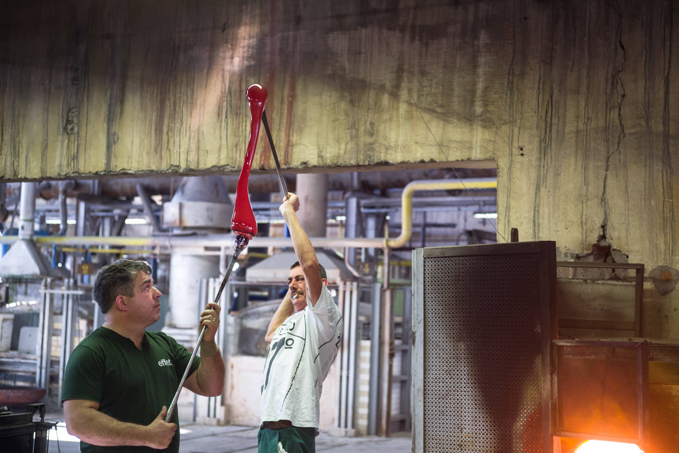 """It's always a pleasure when I am allowed to go inside  a glass factory in Murano . For security reasons, these places are """"off limits"""" for everybody, but sometimes I find a way through and I spend a morning taking pictures of  very ancient art . This is the making of the glass cane that hides the colored  """"Murrine"""" , the images or patterns made with glass. These patterns (since the  Roman empire ) will widely be used for making jewelry, glass vessels, jars, and so on.  Picture taken with my Leica SL, Summicron 50mm, 1/200s f/2,8 iso 800."""