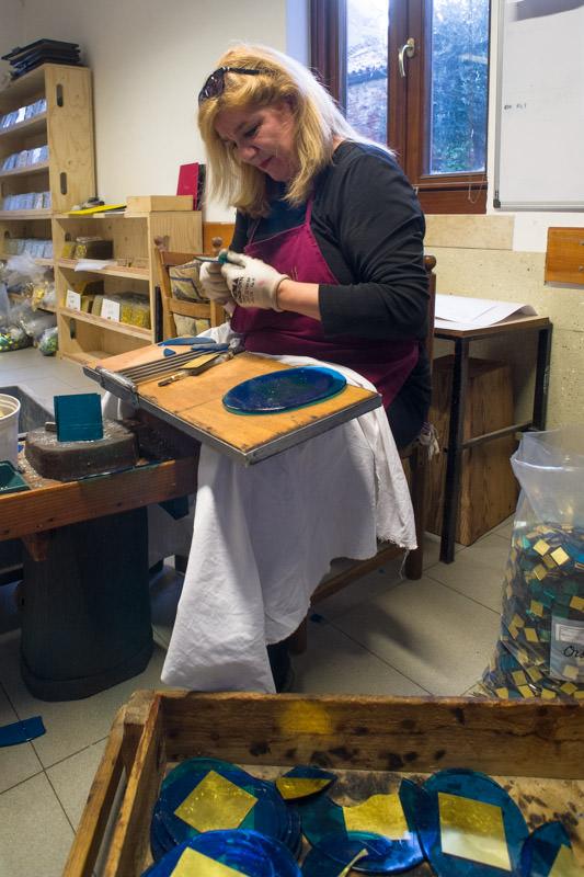 Cutting the mosaic tesserae by hand.