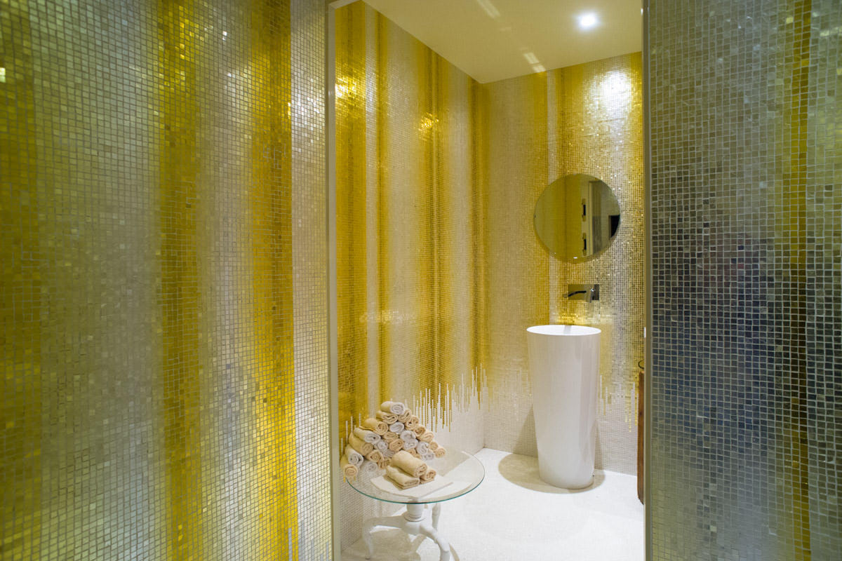 A bathroom made with mosaics and gold leaves