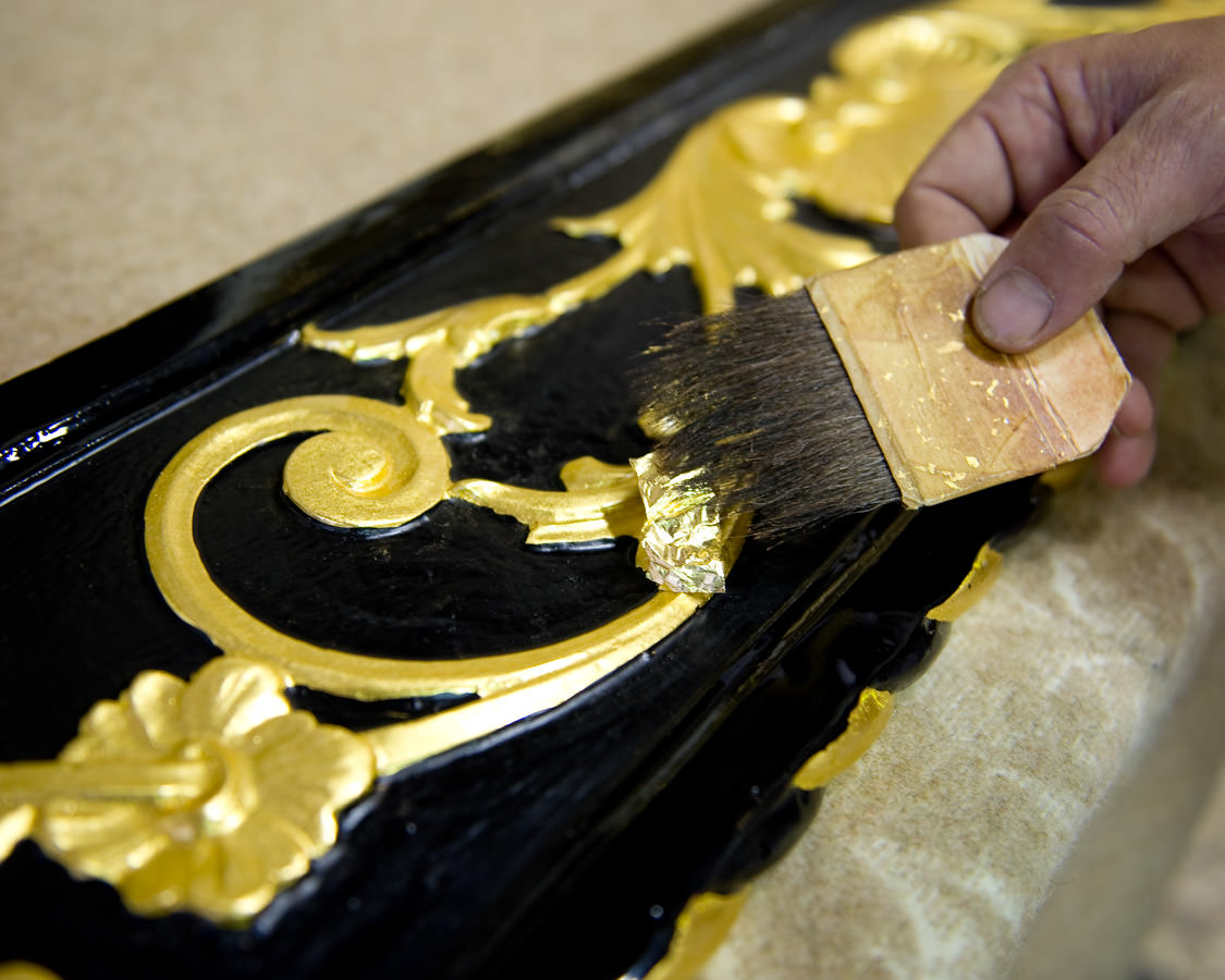 Using a little brush with marten or squirrel hairs, the gold leaf is picked up and placed on the piece