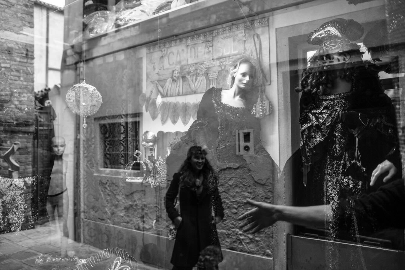 Reflection in a mask shop, in the district of Castello