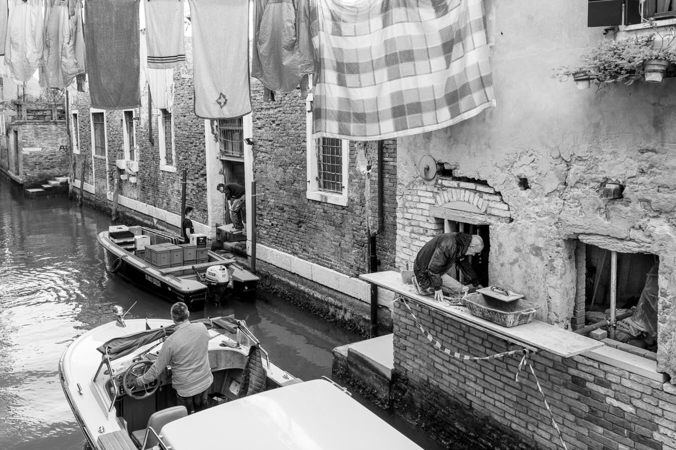 A typical Venetian scene in a narrow canal of Venice