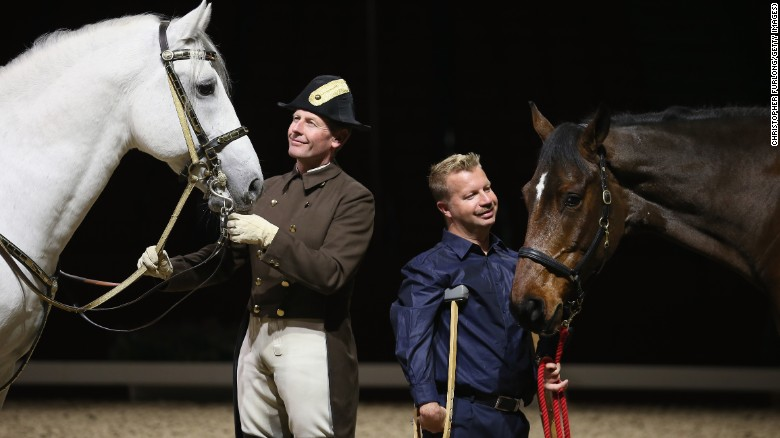 Lee Pearson and Zion (right) with Herwig Radnetter, of the Spanish Riding School