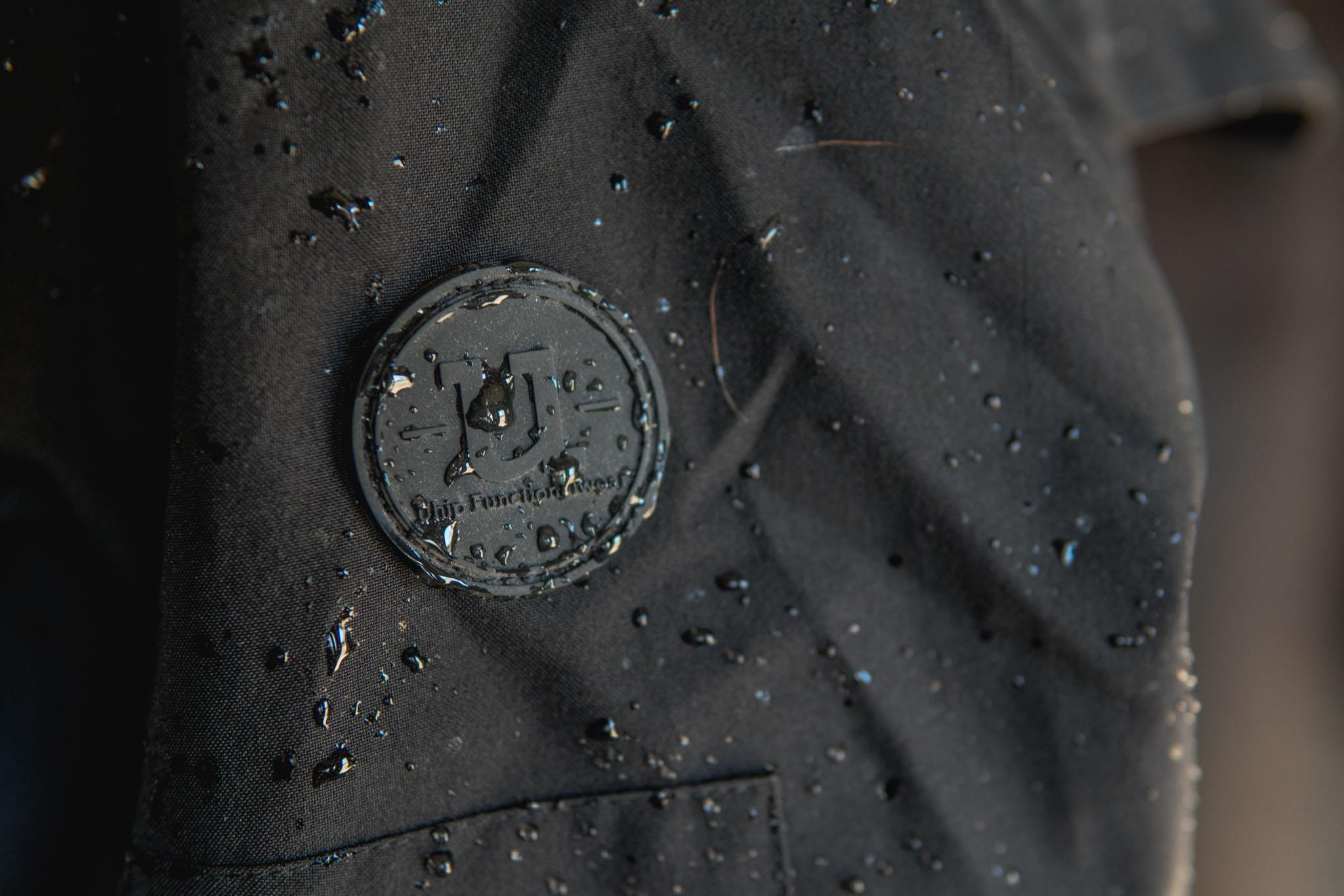 Uhip black mid length trench wet.jpg