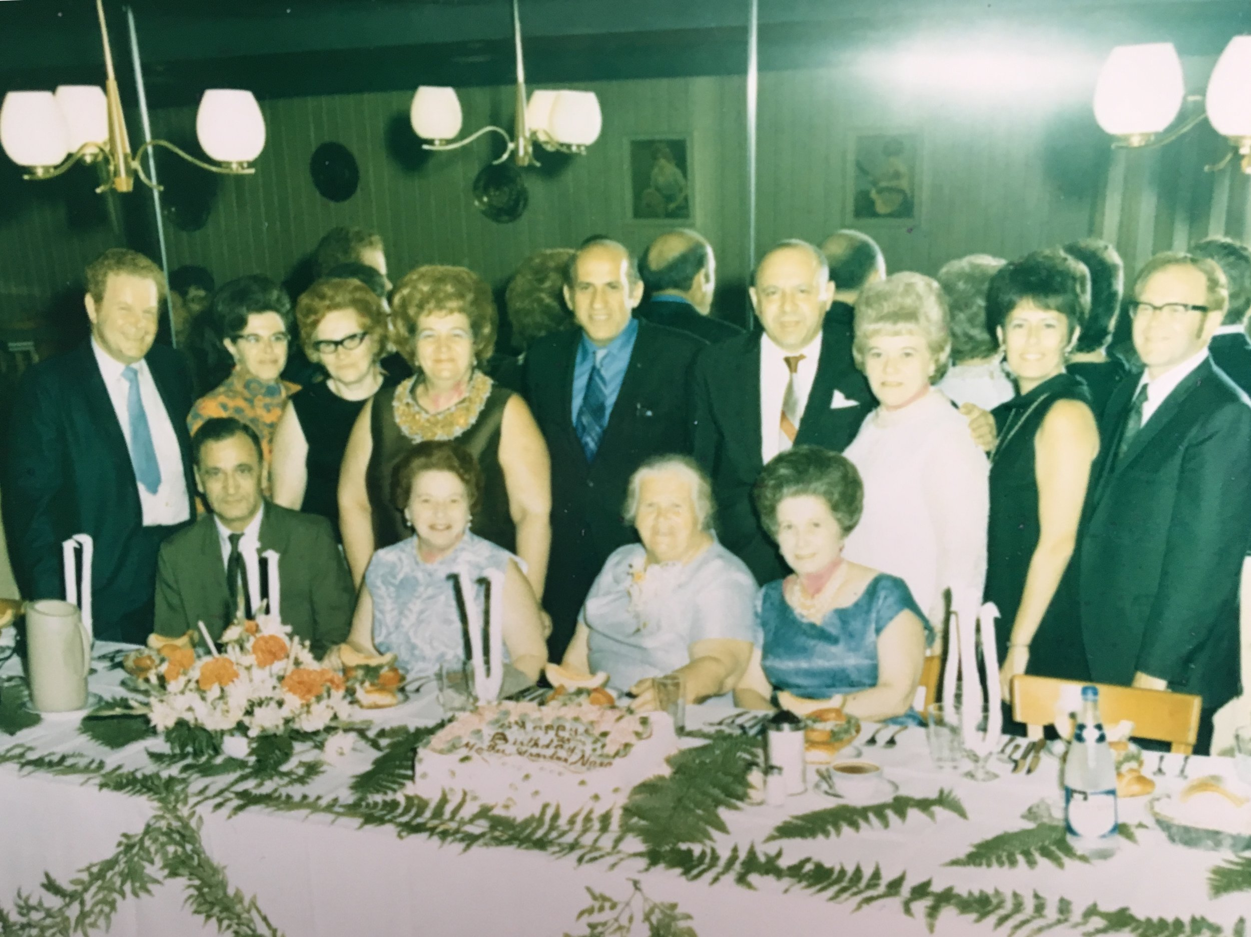 Fannie Polirer Strassner at her 75th birthday party with her seven children and their spouses.  Image courtesy of Amy Scully