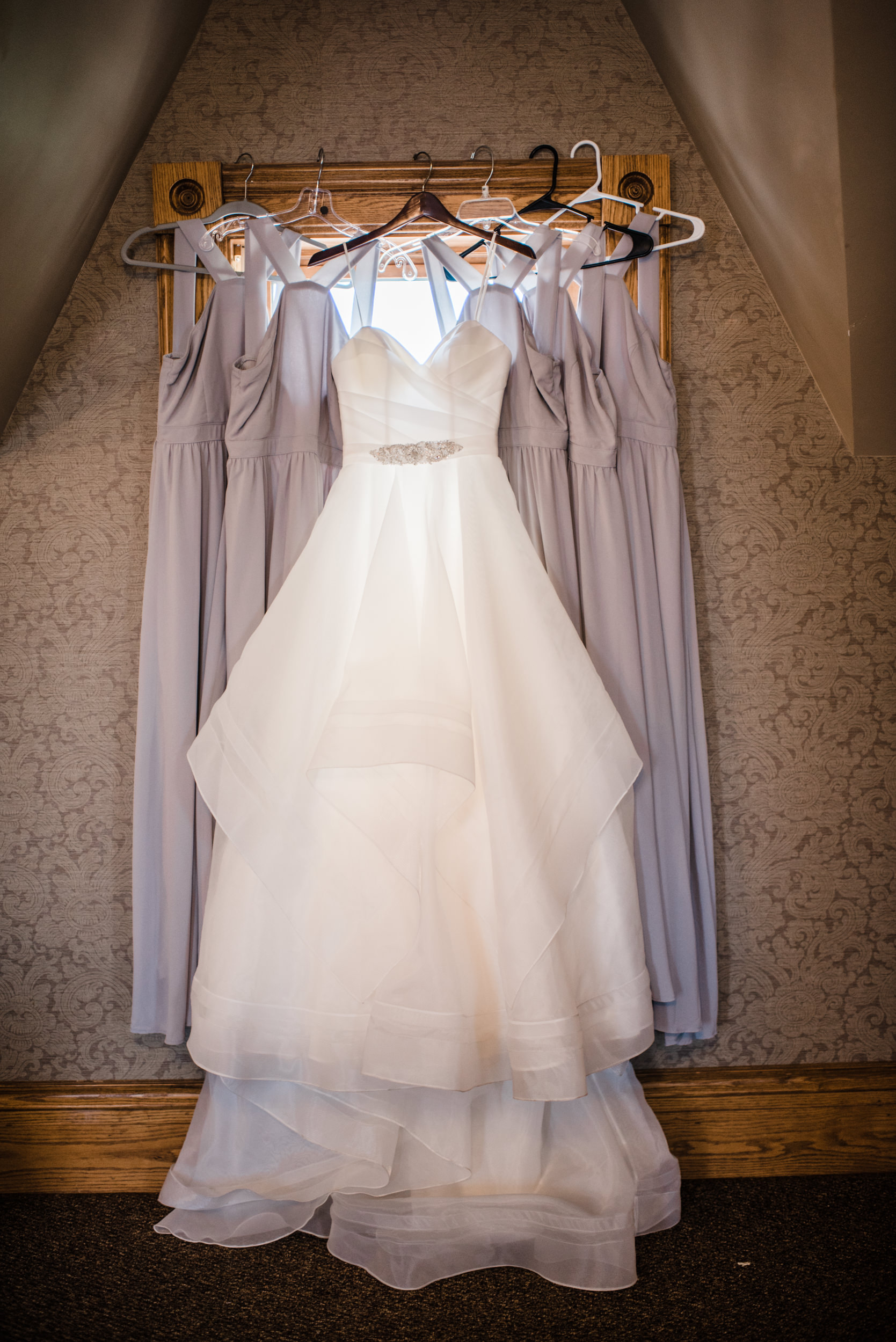 Colorado mountain wedding photographer at Brookeside Gardens showing wedding dresses and bridesmaid dresses.