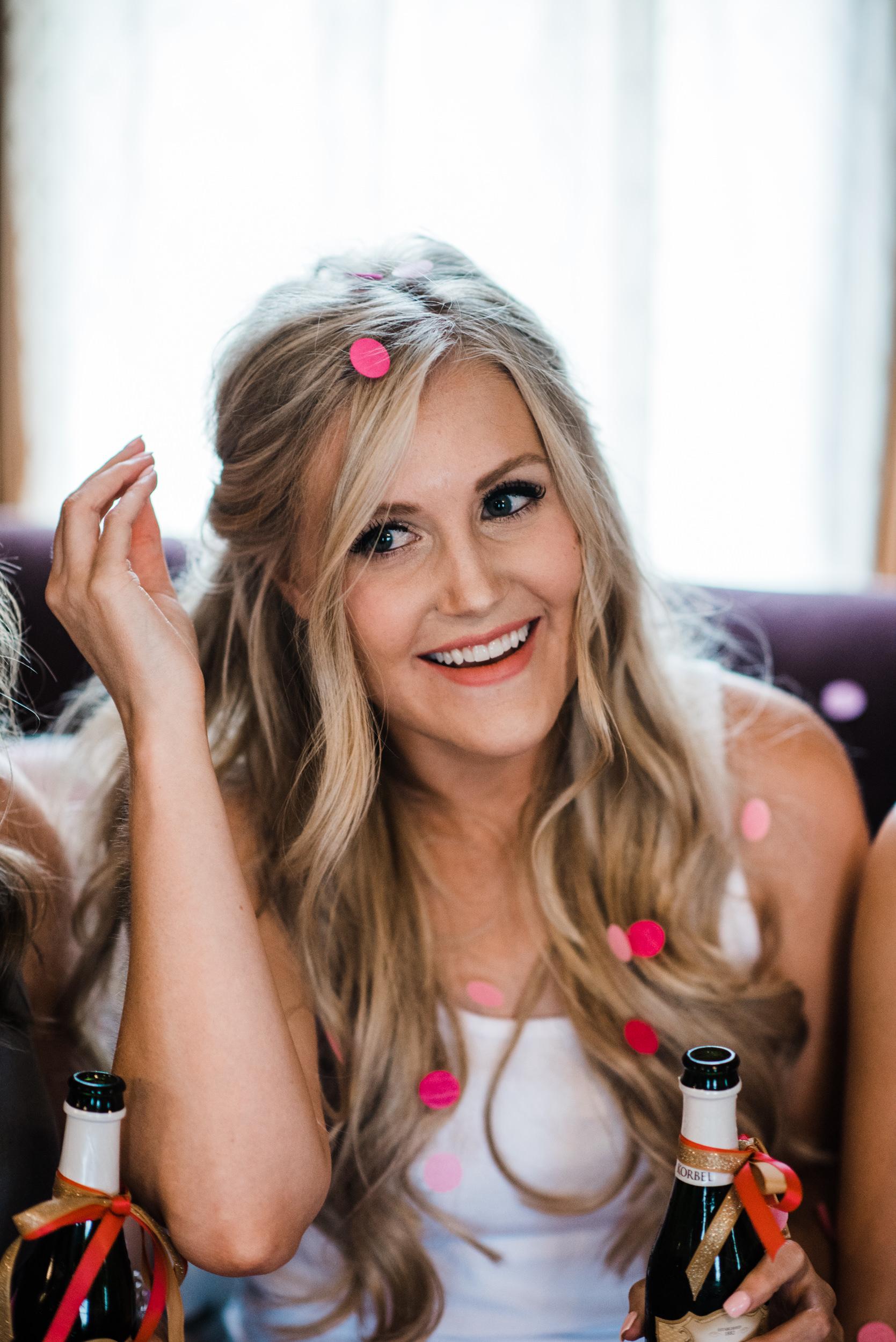 Colorado mountain wedding photographer at Brookeside Gardens bride with confetti in her hair