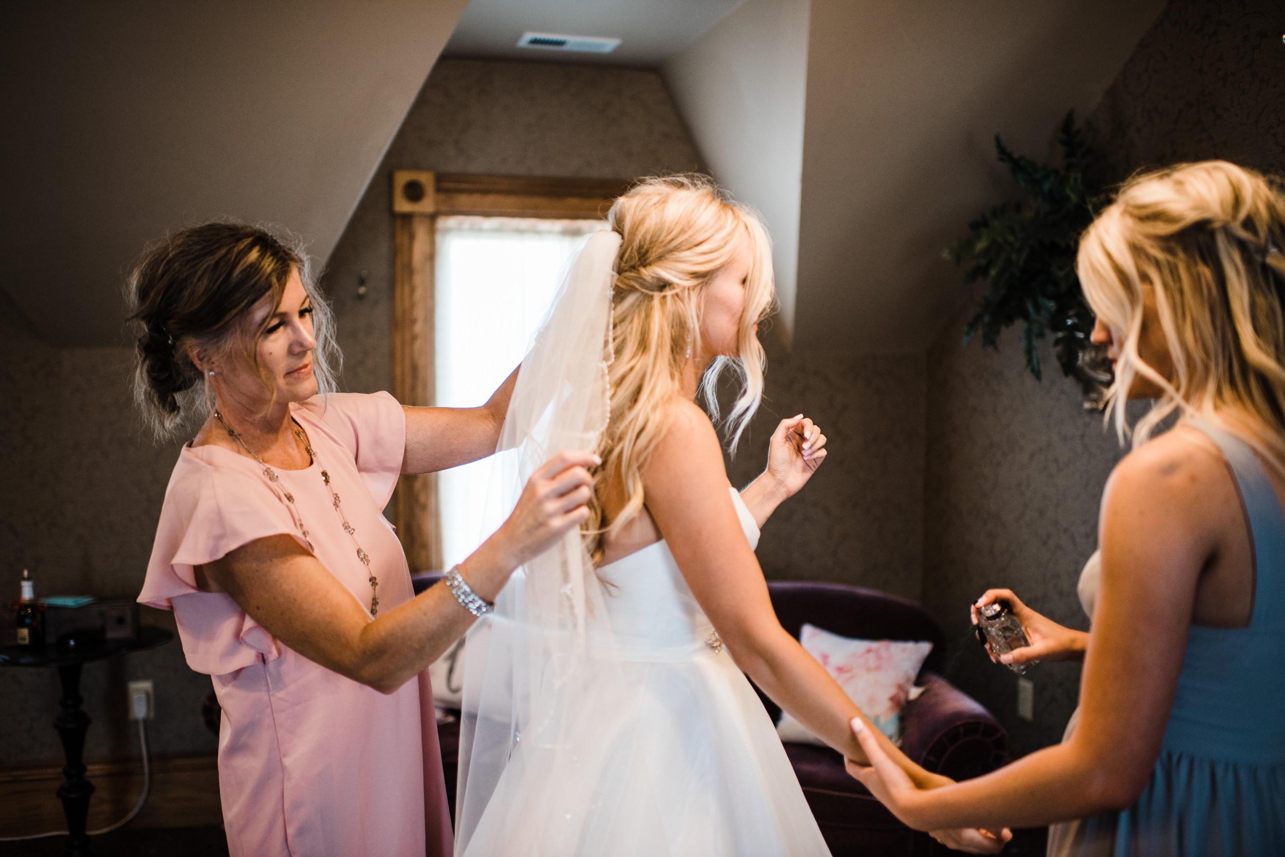 Colorado mountain wedding photographer at Brookeside Gardens with bride and maid of honor.