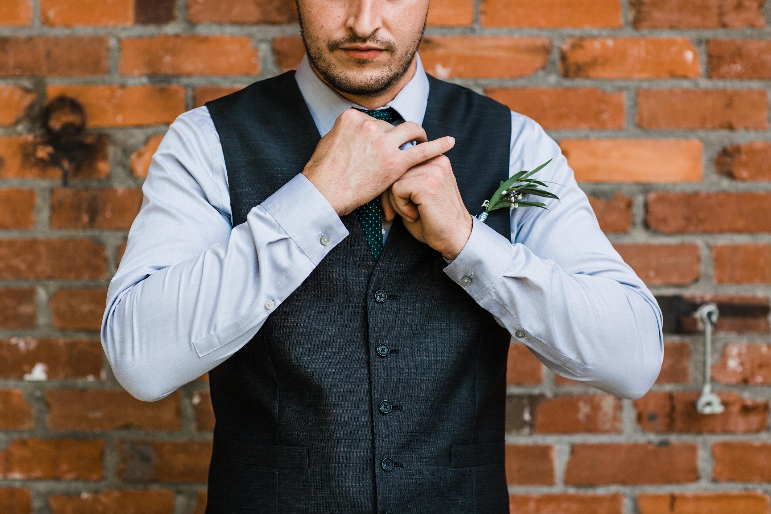 Colorado mountain wedding photographer at Brookeside Gardens groom getting ready