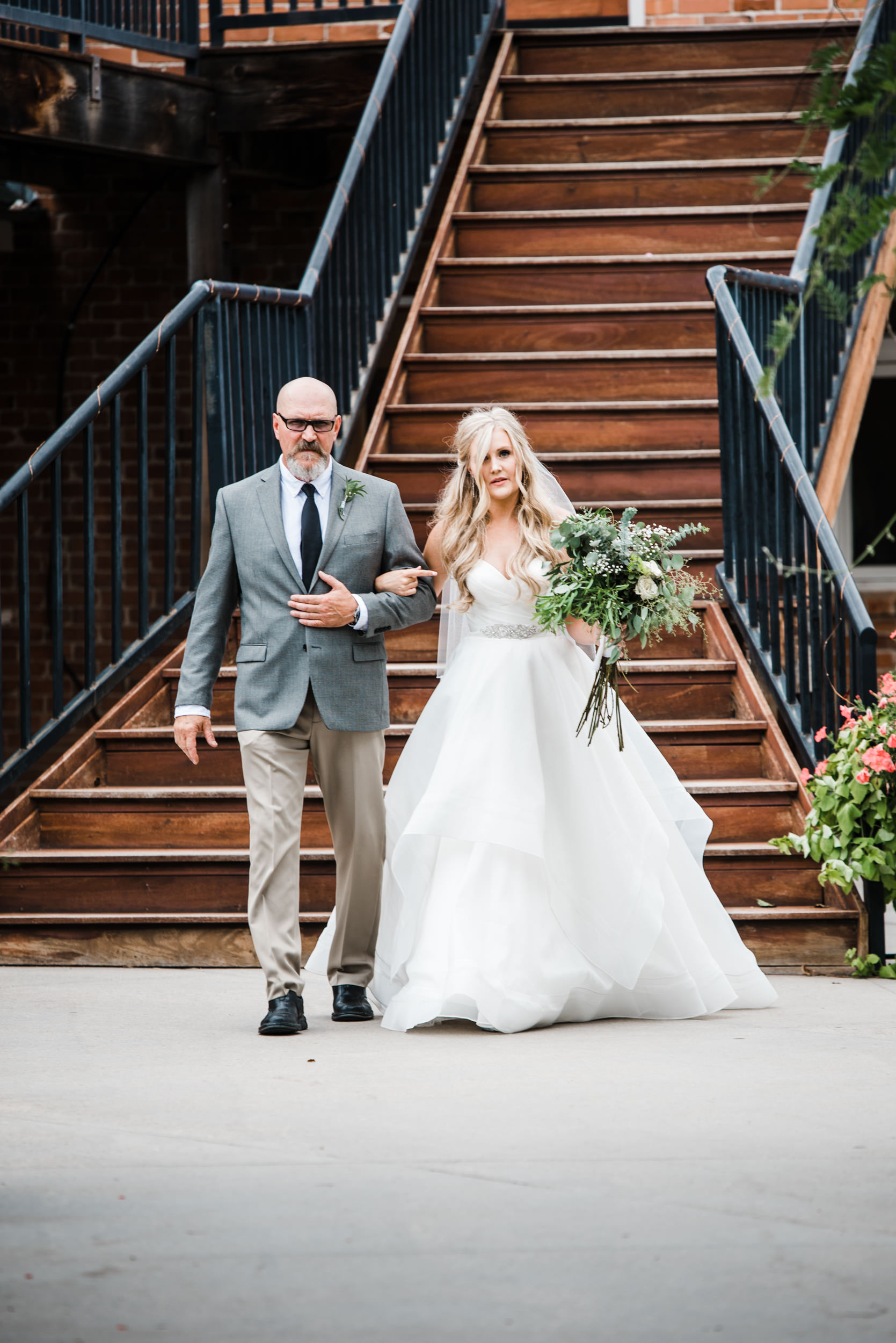 Colorado mountain wedding photographer at Brookeside Gardens father of the bride and bride headed down the aisle