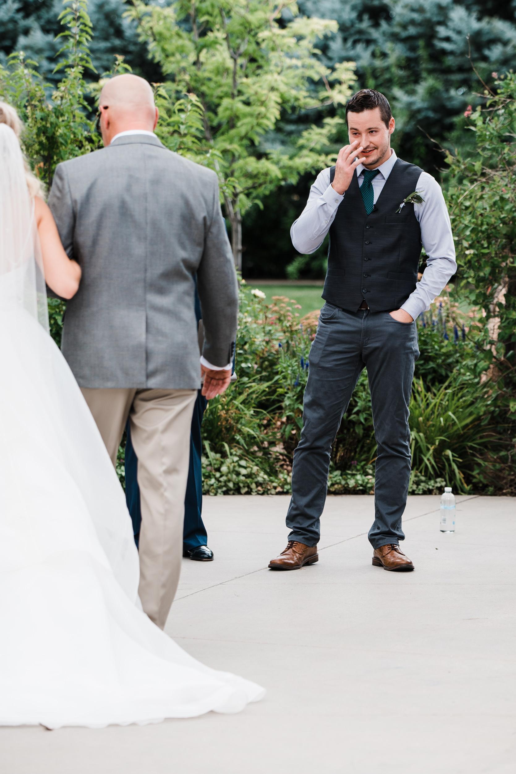 Colorado mountain wedding photographer at Brookeside Gardens groom first look