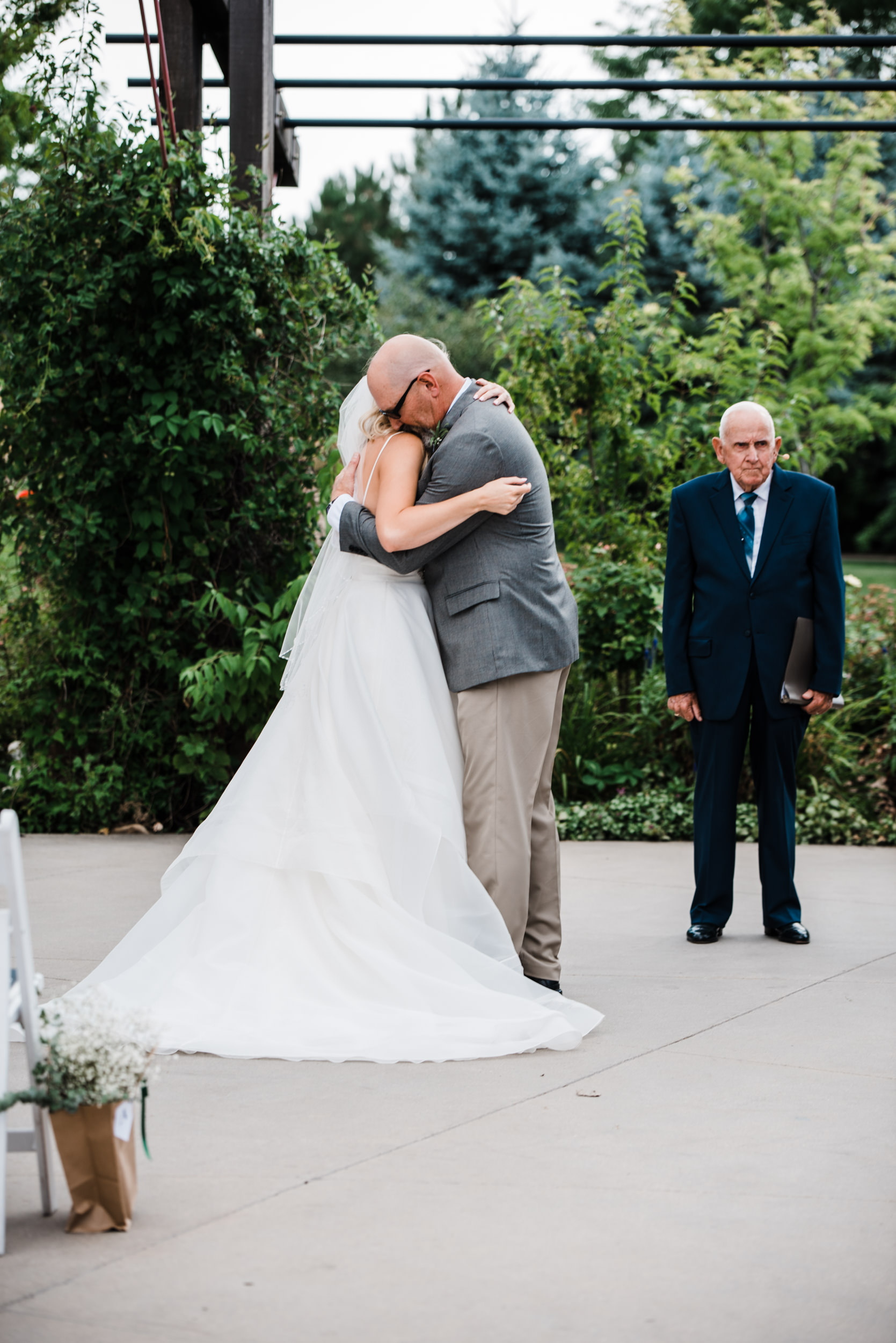Colorado mountain wedding photographer at Brookeside Gardens father of the bride giving bride away