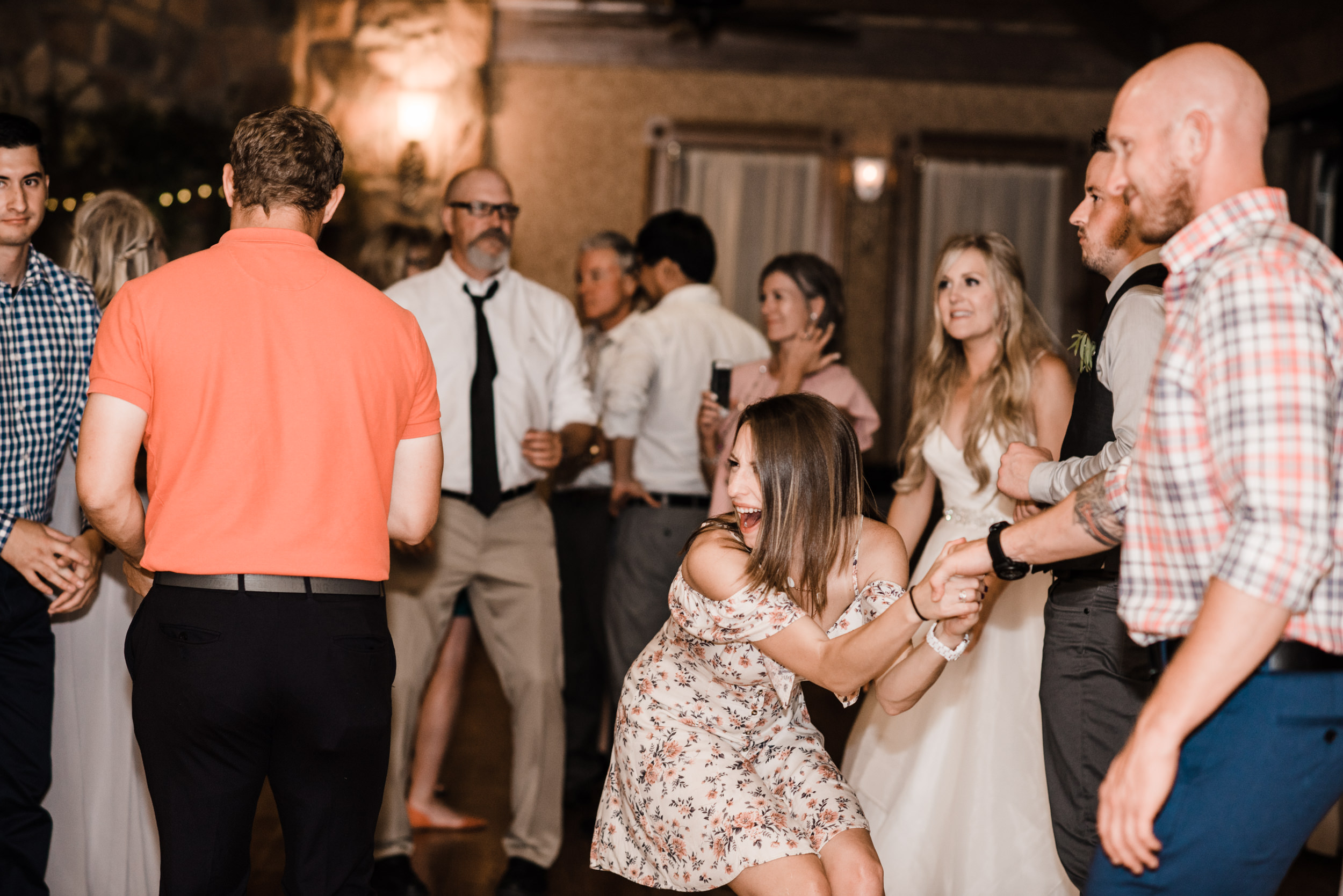 Colorado mountain wedding photographer at Brookeside Gardens wedding reception people dancing and having a good time