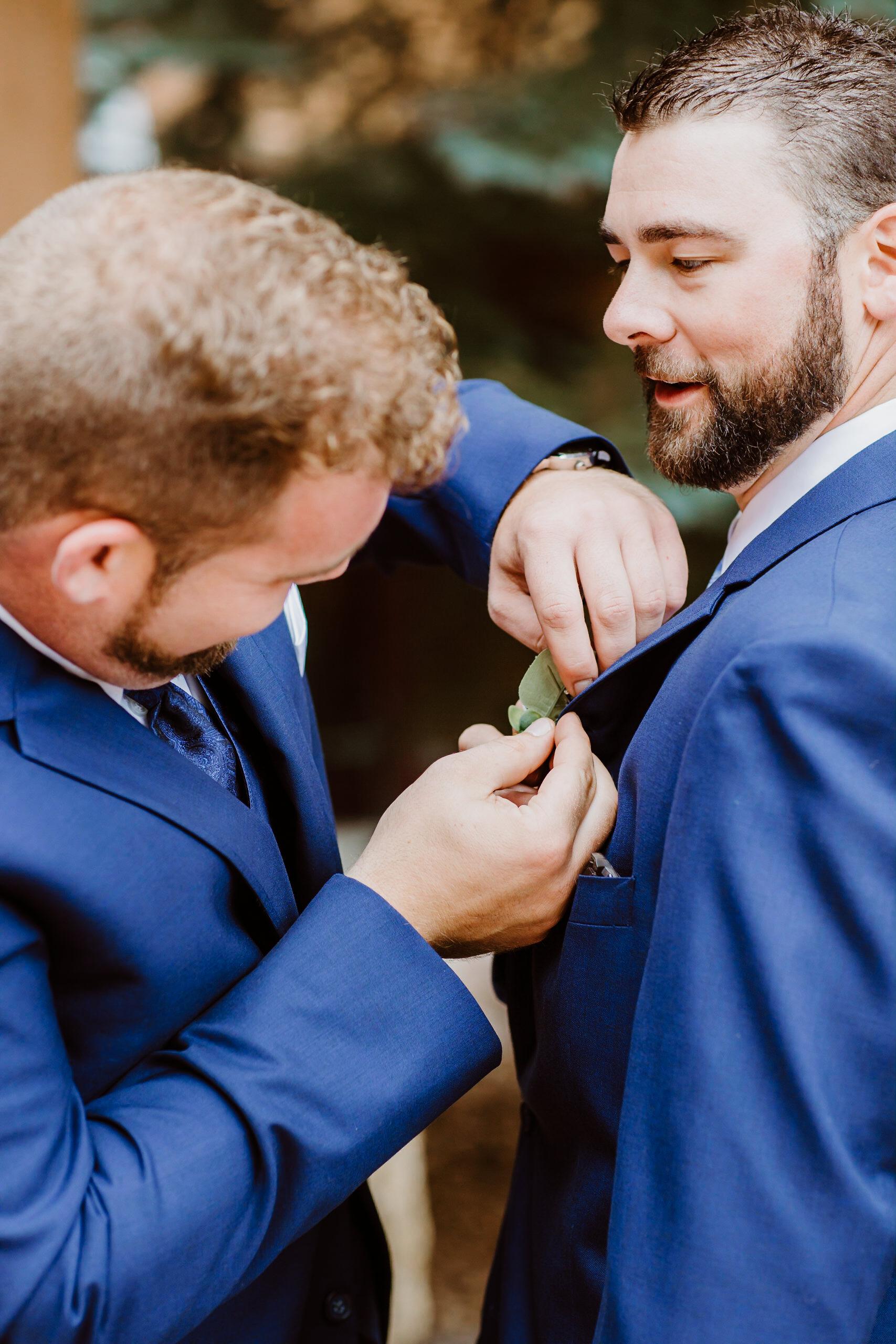 Groom and best man getting ready at Keystone, Colorado mountain wedding