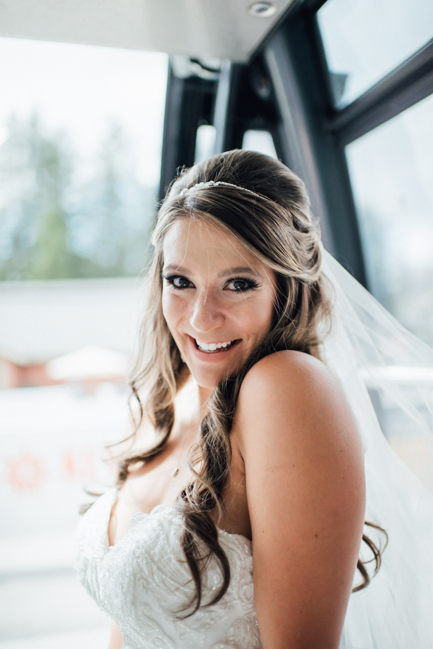 Bride on gondola at Keystone, Colorado mountain wedding