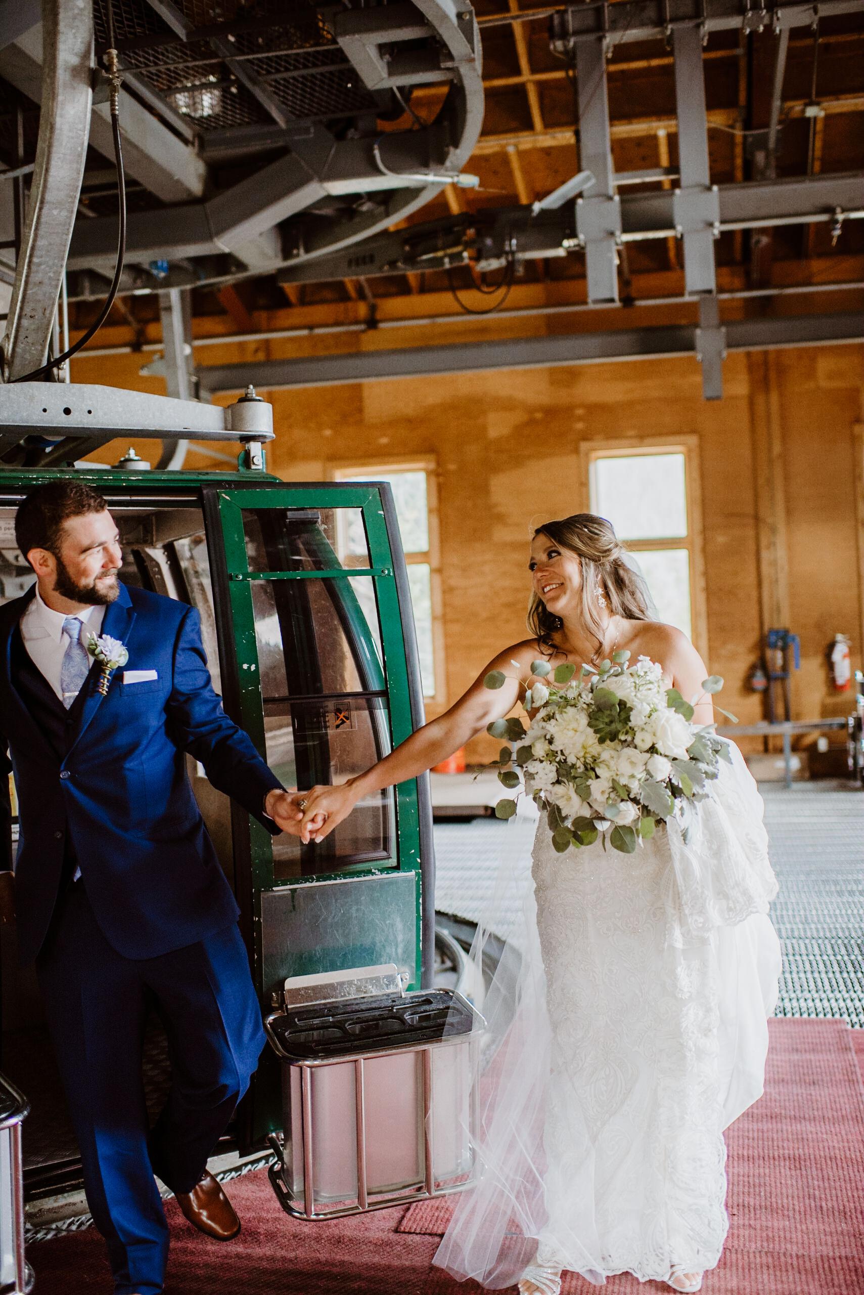Bride and groom on gondola at Keystone, Colorado mountain wedding