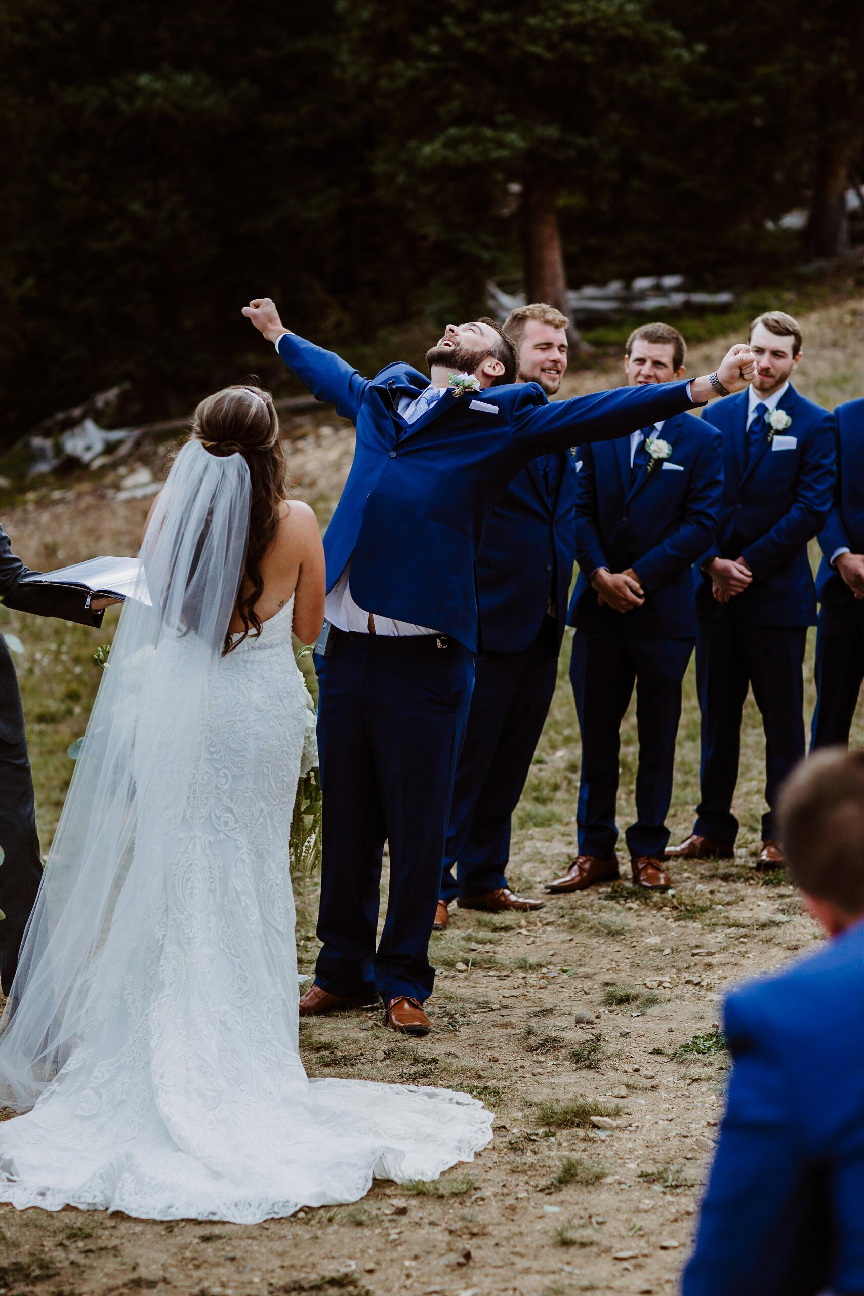 Bride and Groom at ceremony at TImber Ridge at Keystone, Colorado mountain wedding