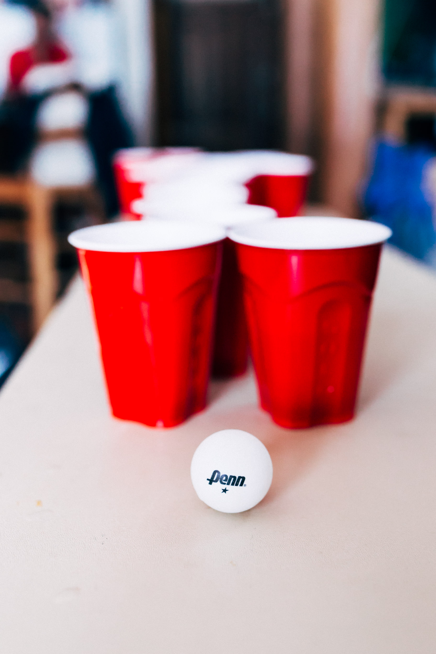 Beer pong at fun Colorado wedding.