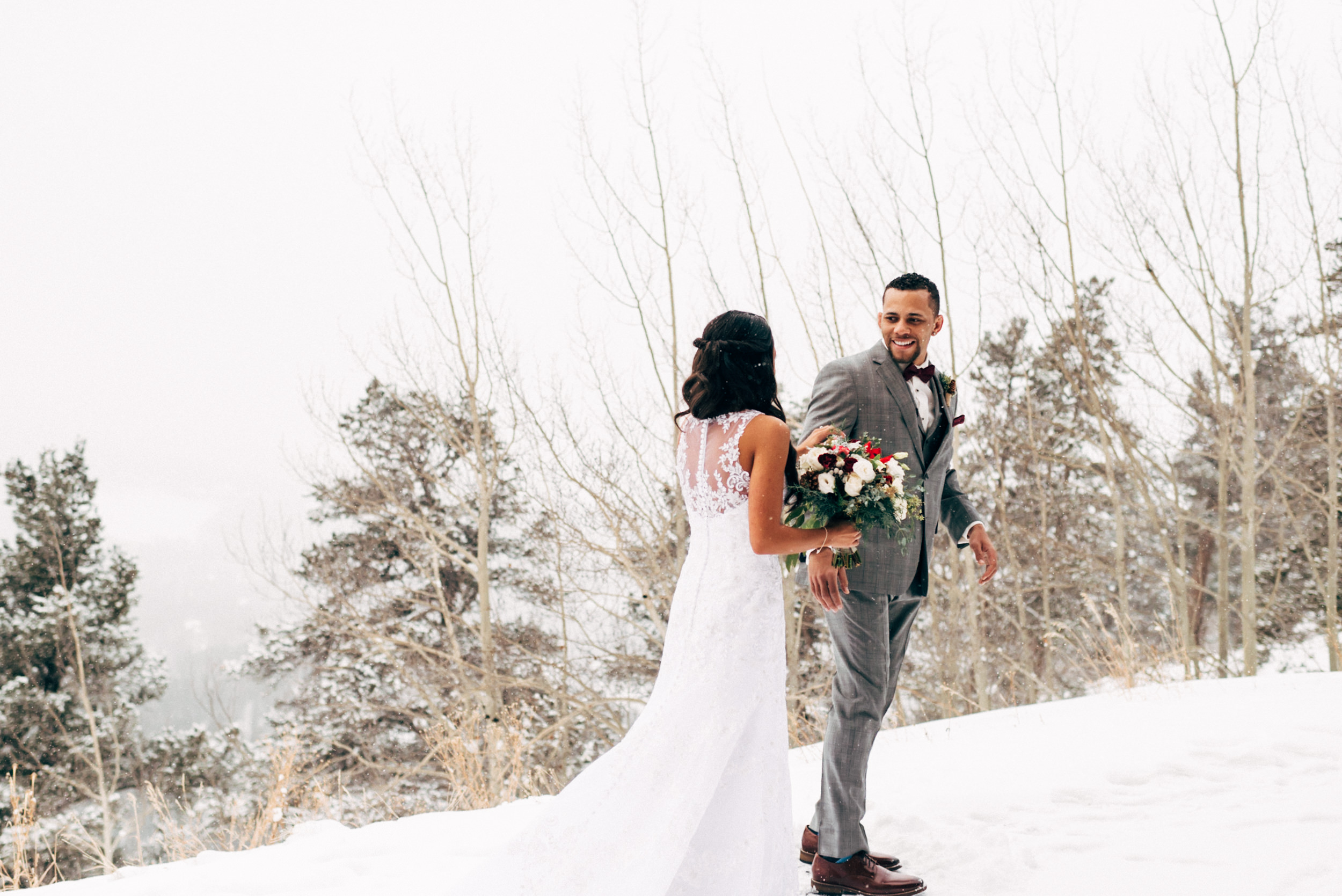 First look at winter wedding on Colorado mountain wedding. Colorado wedding photographer.