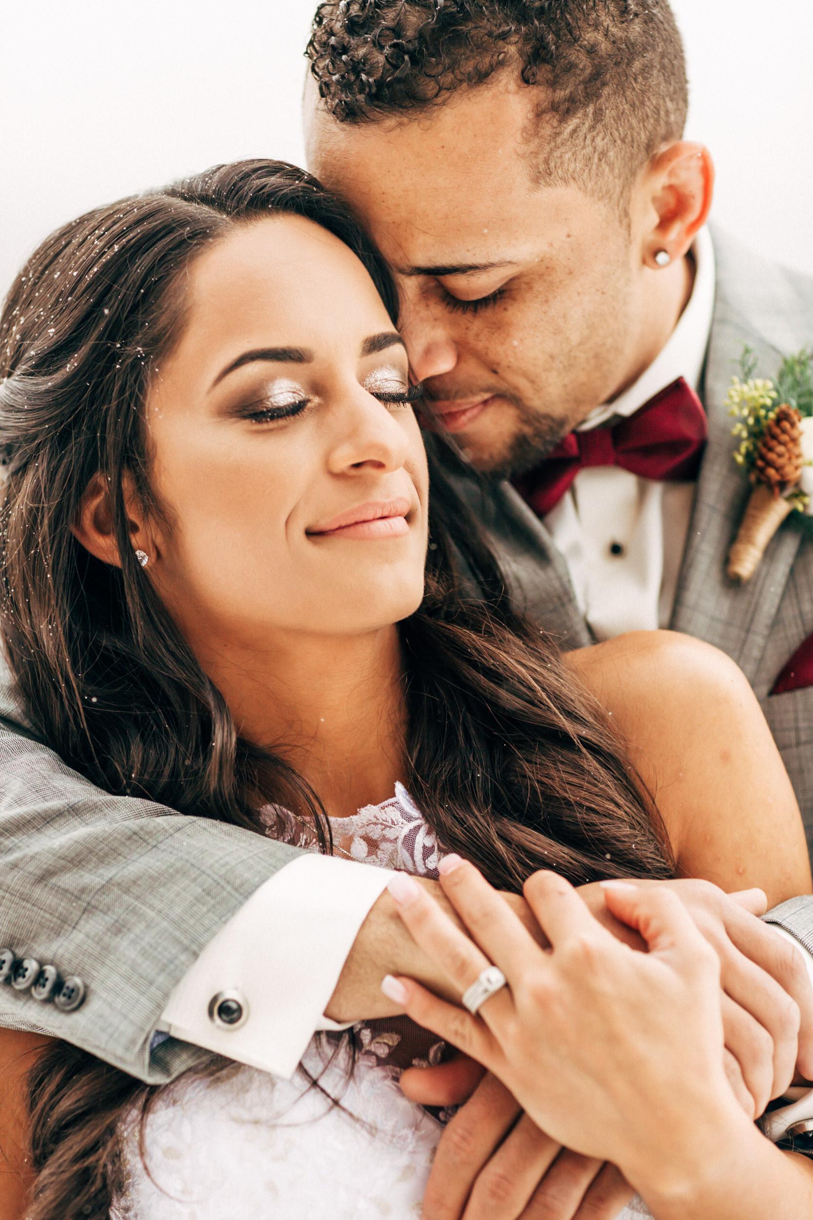 Hugs on a Breckenridge mountainside Colorado Wedding Photographer.