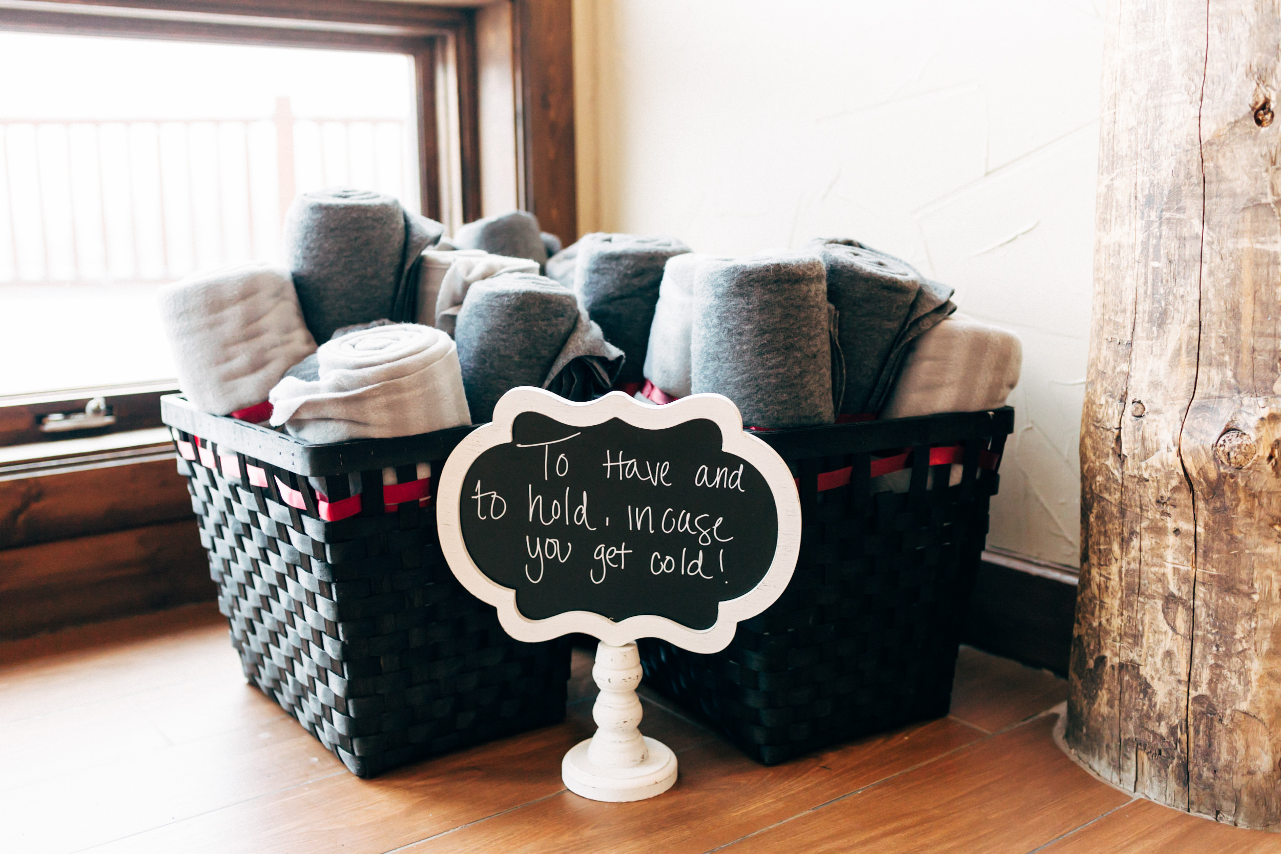 Warm loving blankets to keep guest warm at wedding ceremony at The Lodge in Breckenridge, Colorado. Colorado wedding photographer.
