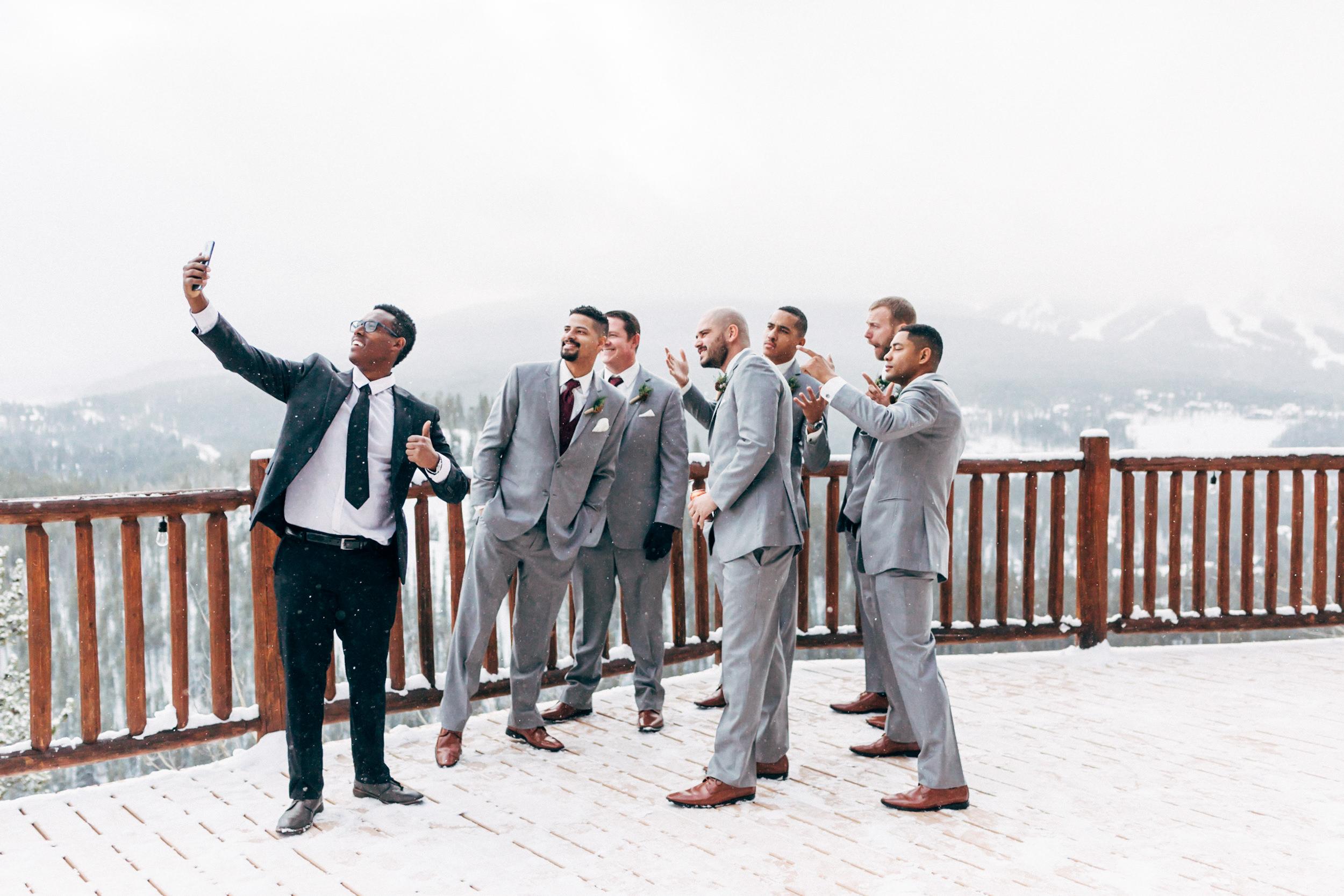 Groomsmen goofing off on Breckenridge Lodge deck. Colorado wedding photographer.