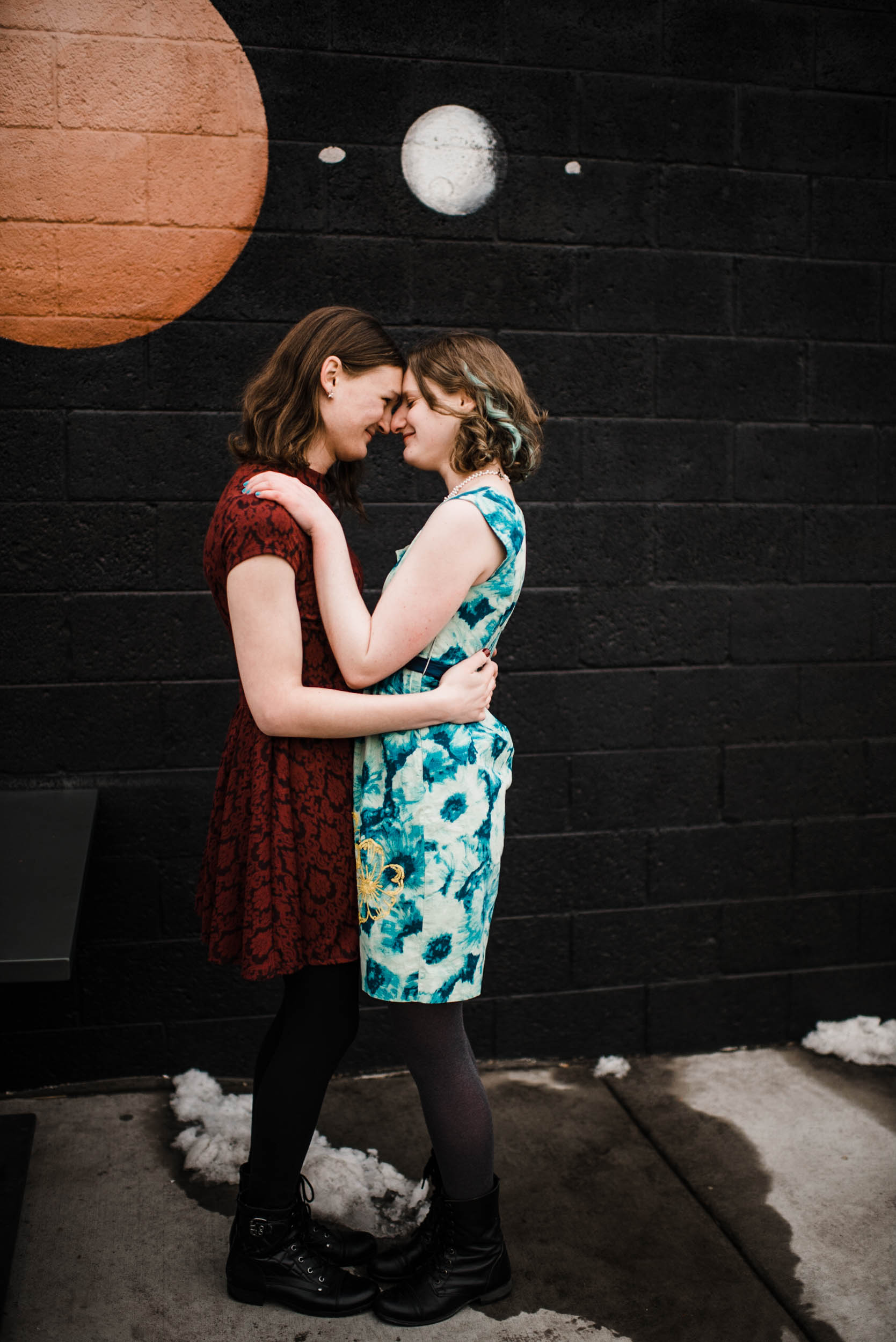 Dancing in the cold at Denver Colorado RiNo art mural, RiNo Arts District, RiNo engagement session, LGBT wedding photographers, LGBT friendly wedding photographers, LGBT engagement photographers, Denver wedding photographers, Denver Engagement photographers