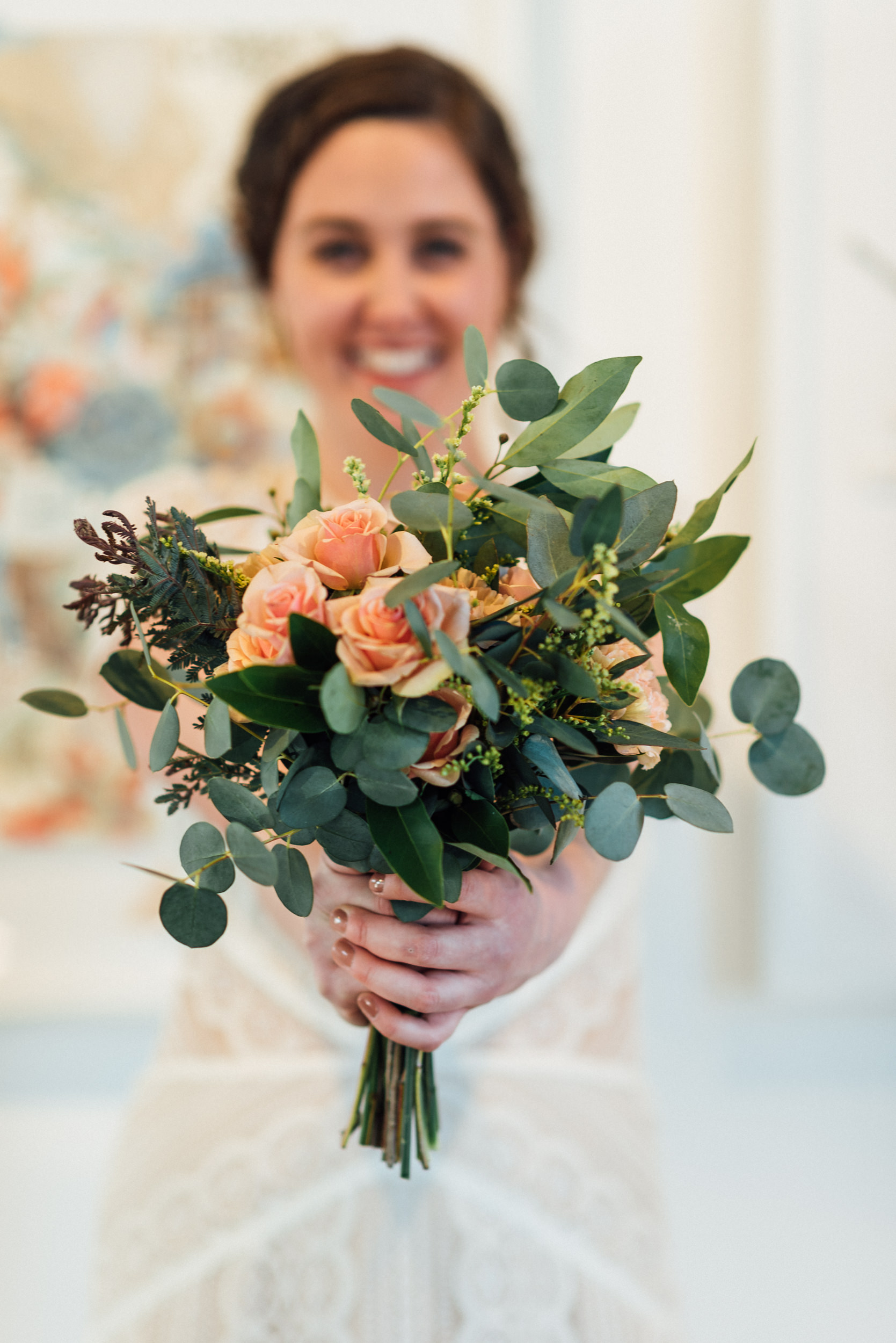 Bride at Space Gallery with her gorgeous flowers-Space Gallery Wedding Photographer