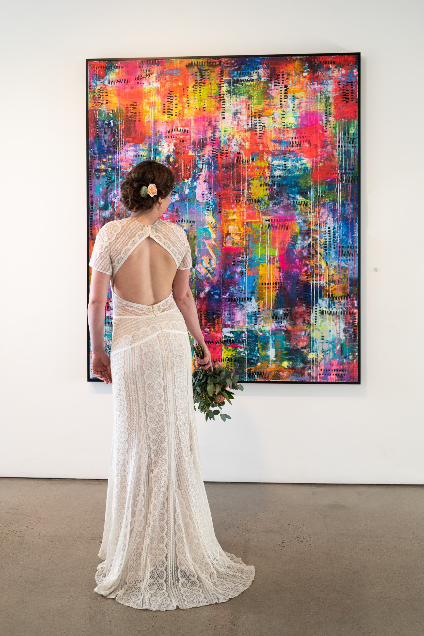 Bride and painting and Space Gallery at Denver wedding-Top Denver wedding photographer