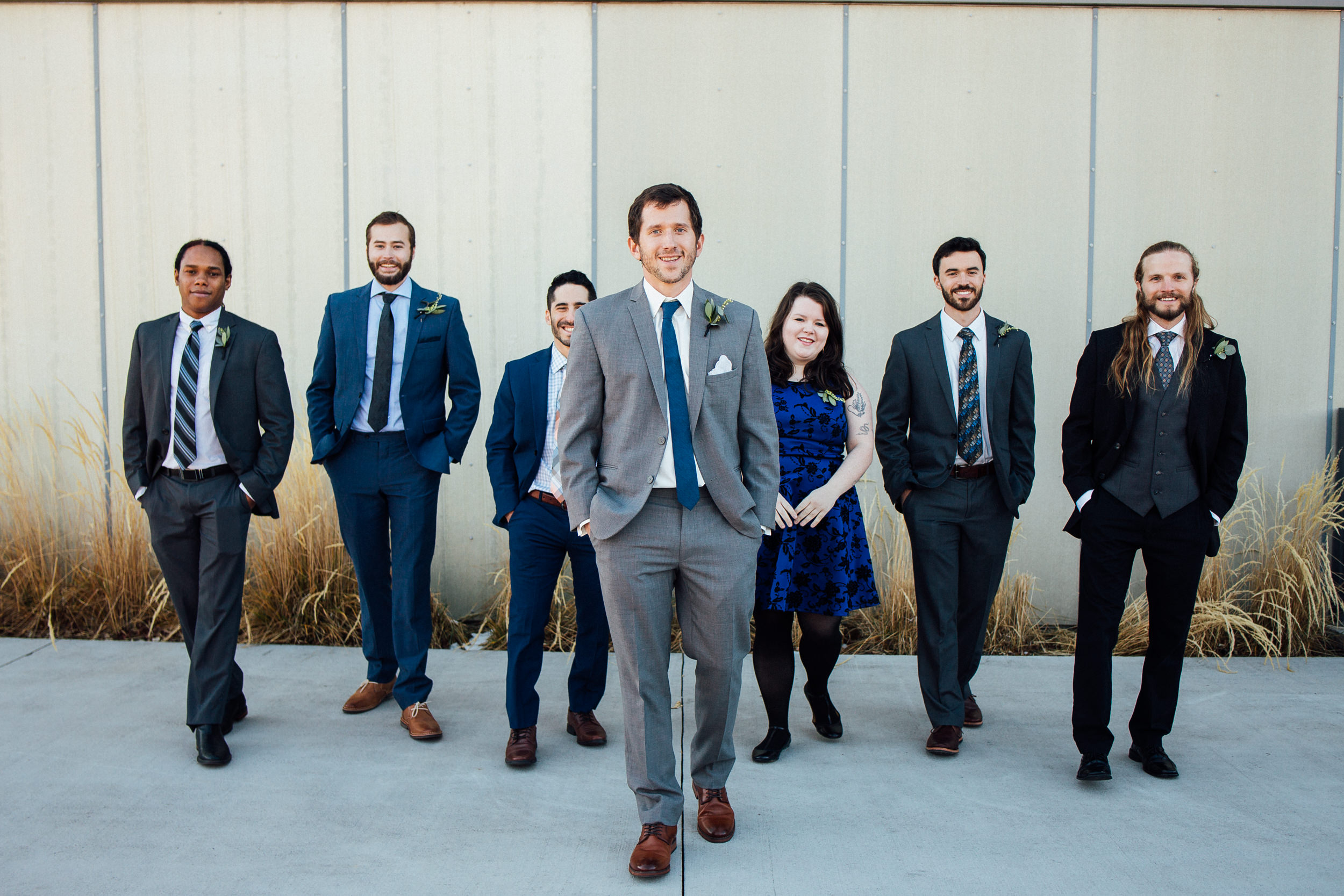 A groom and his men and woman at Space Gallery-Denver-Colorado Kate Photography