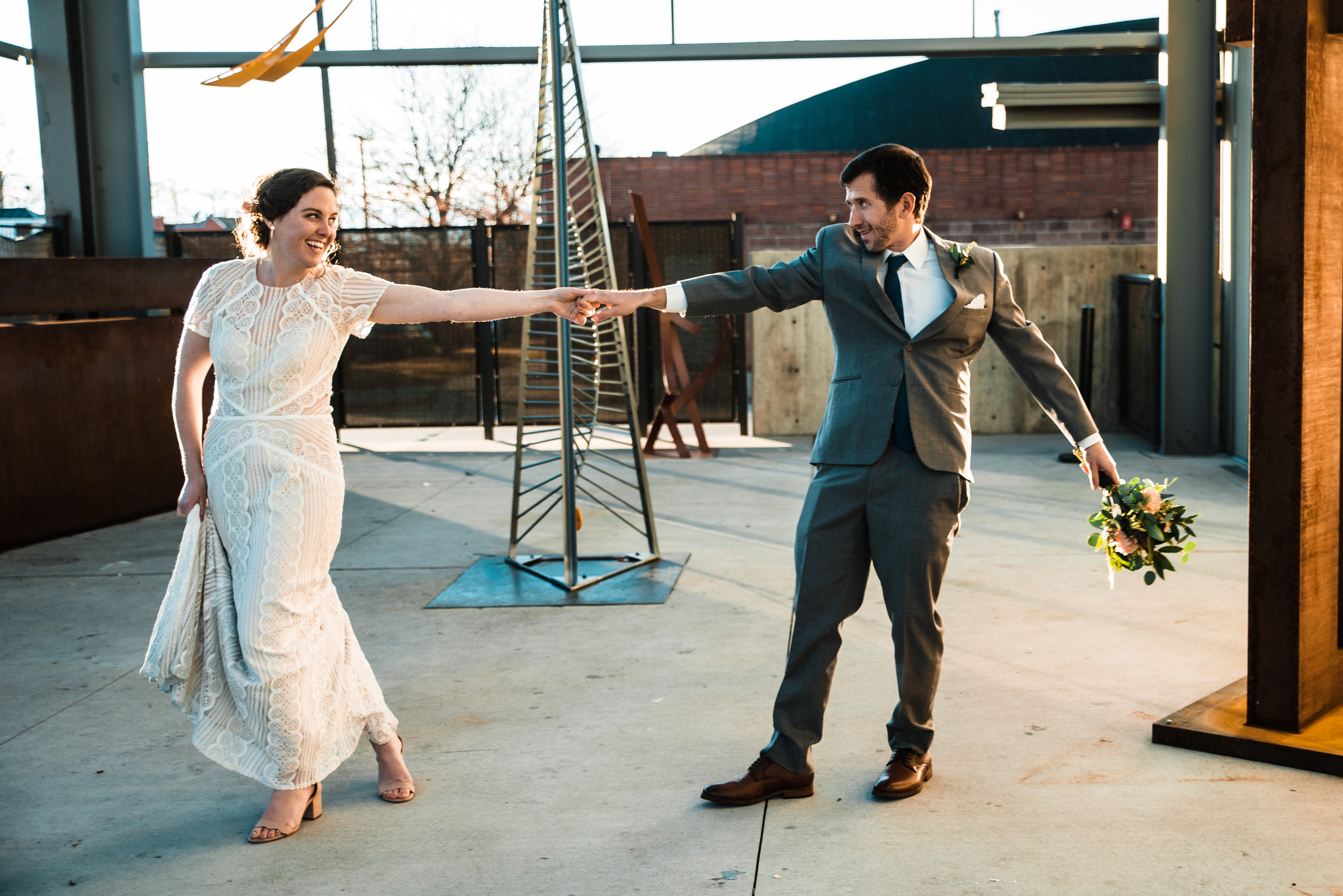 Wedding dancing at Space Gallery sculpture garden at intimate Colorado wedding-Best Colorado Wedding Photographer