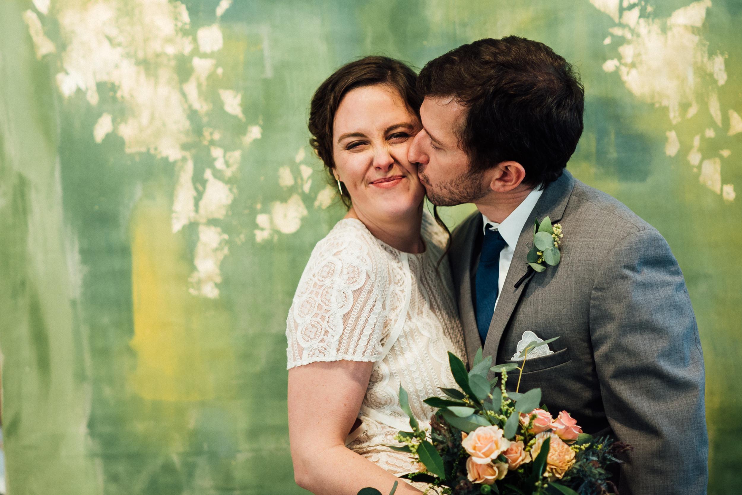 Bride and groom kissing at a Denver, Colorado Space Gallery wedding-Colorado Kate Photography