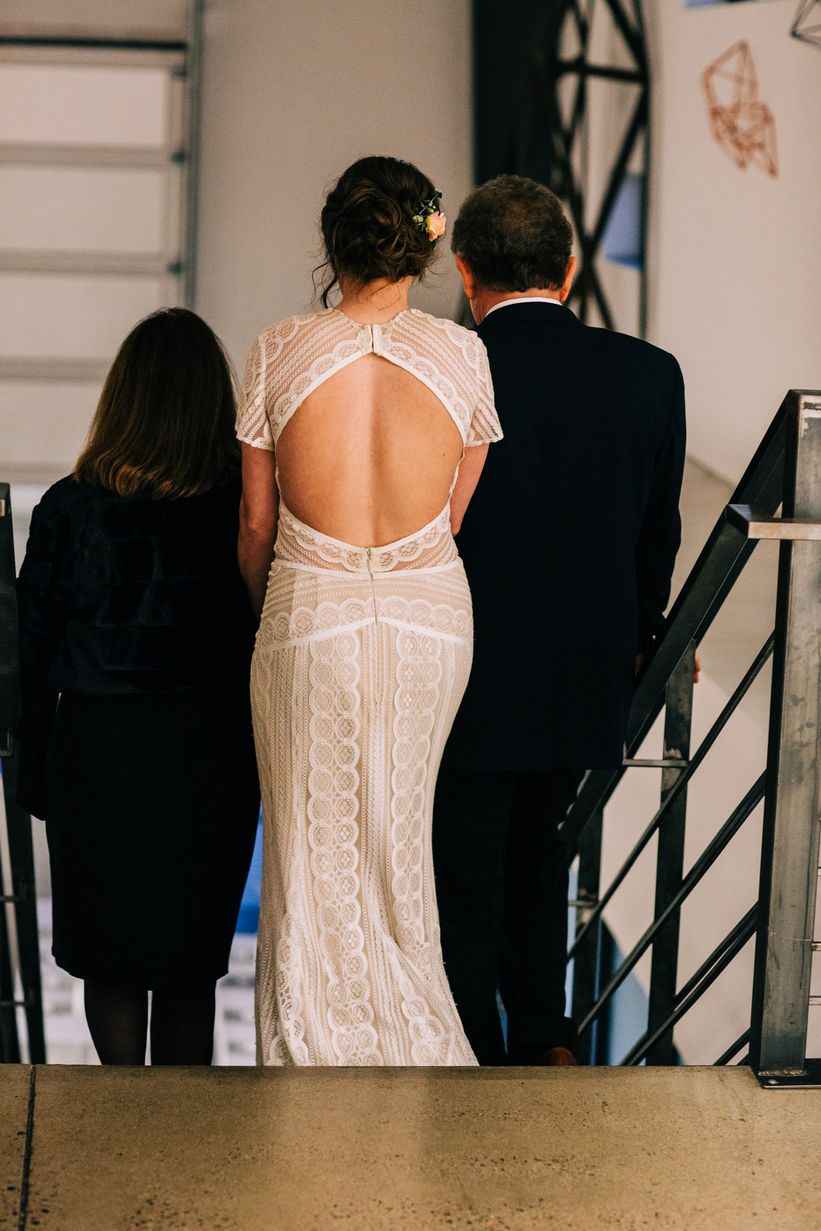 Bride, Mom and Dad walking down the aisle at Space Gallery in Denver Colorado.