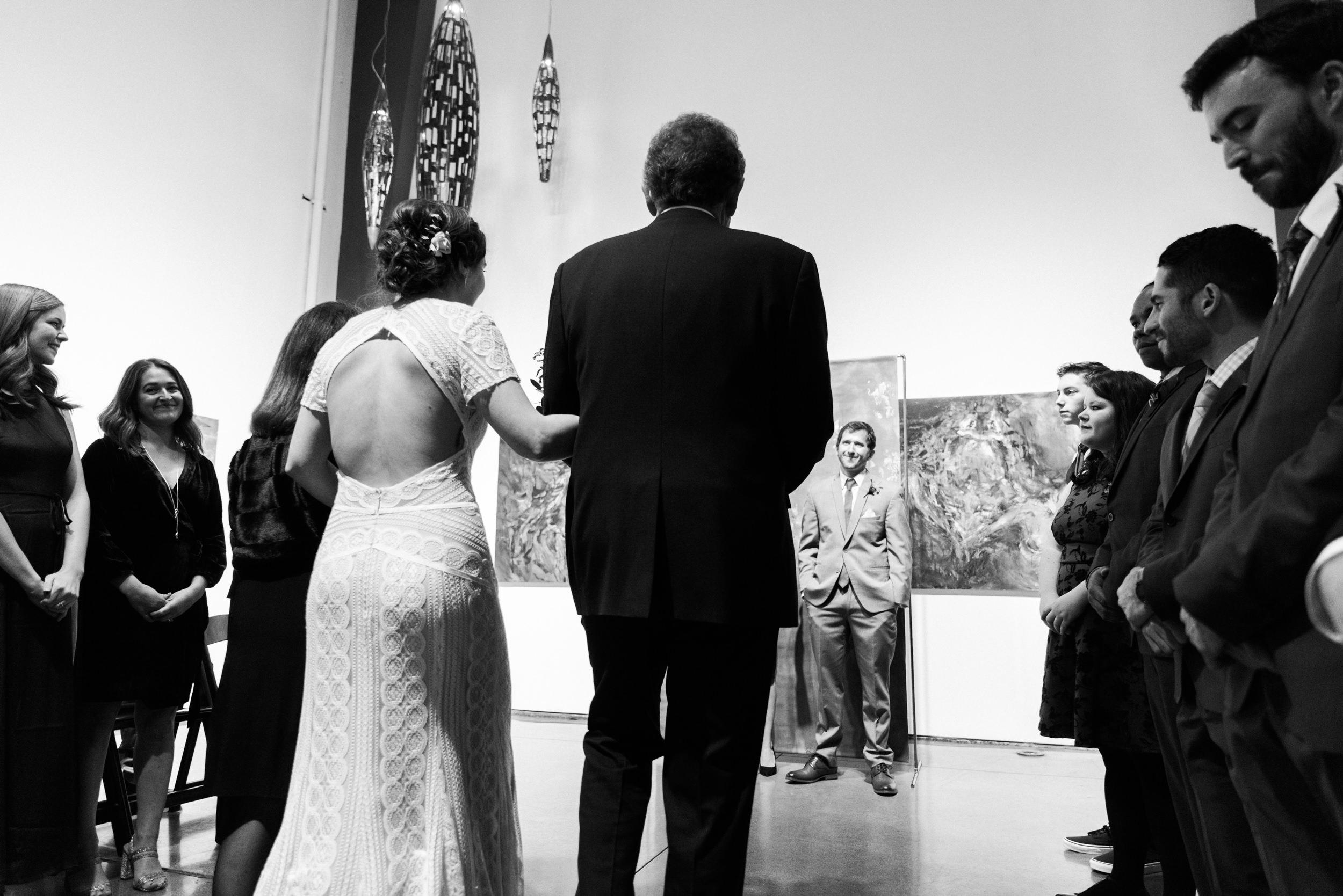 Father giving away the bride at Space Gallery, Denver Colorado Wedding-Colorado Kate Photography
